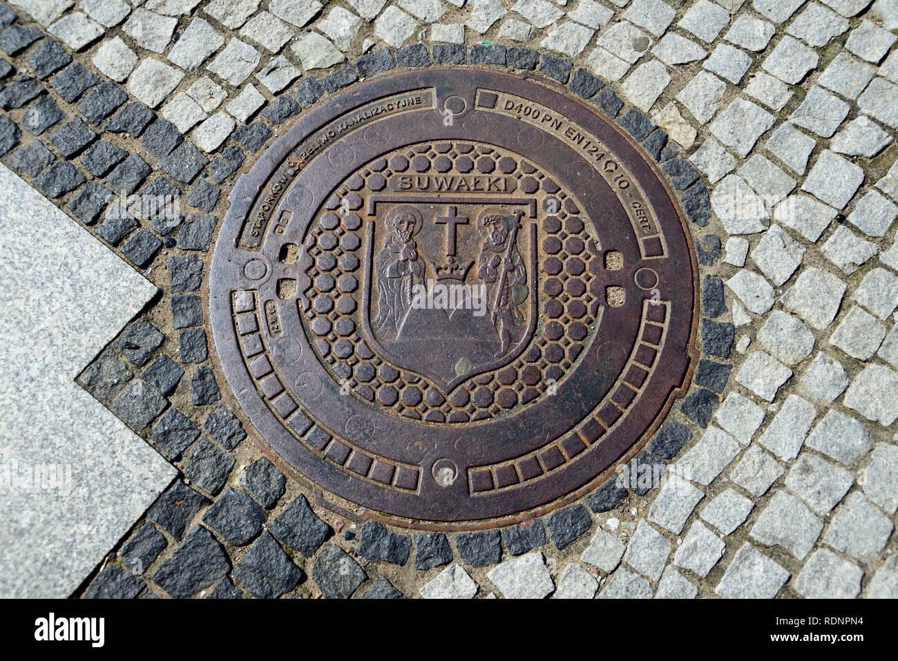 Manhole cover, Suwalki, Podlaskie, Poland - Stock Image