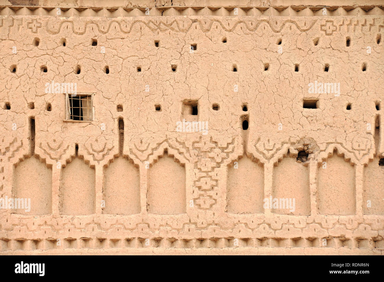 Adobe Mud Wall Details and Earth Construction Pattern Casbah Ouarzazate Morocco - Stock Image