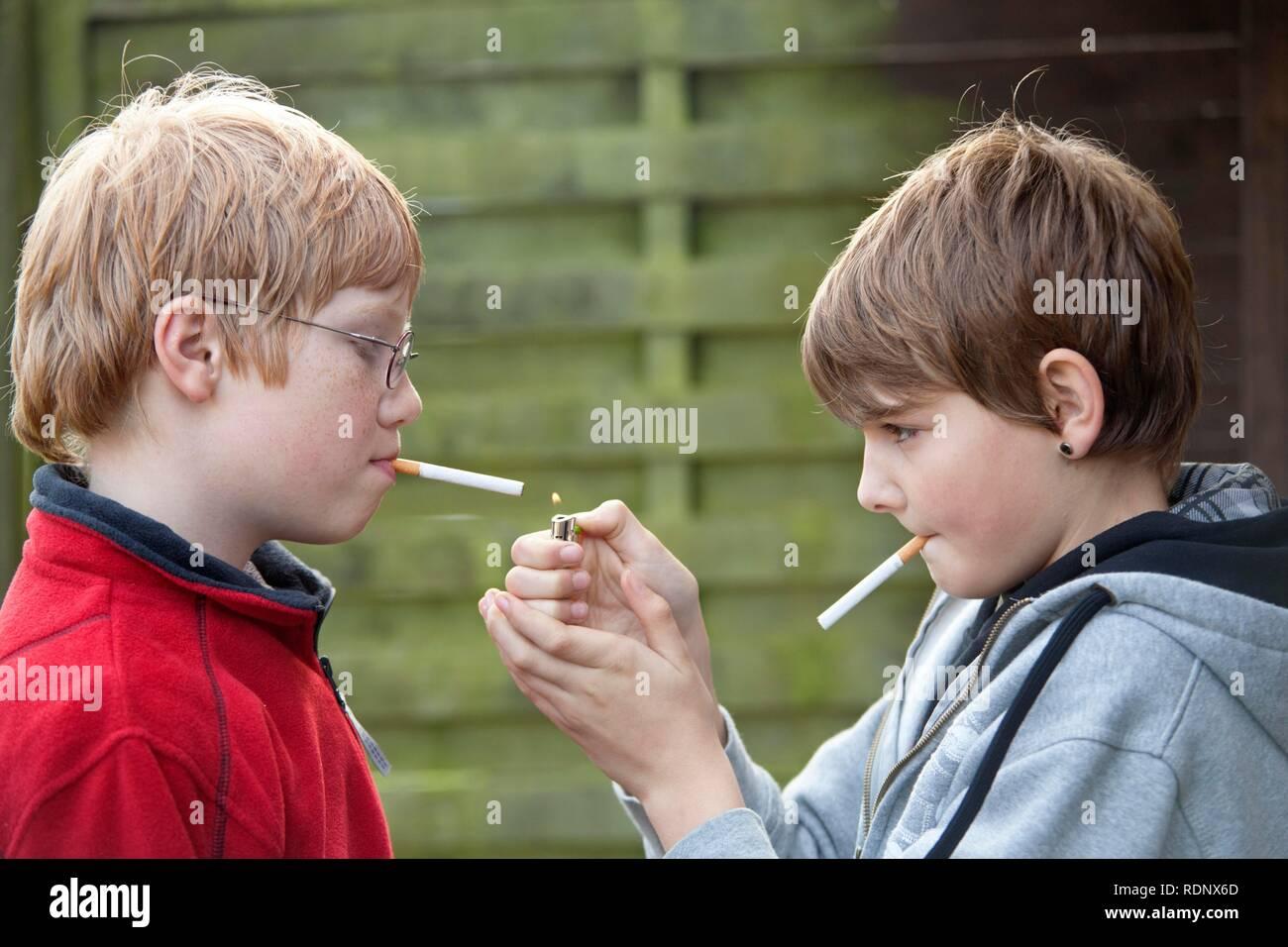 Under age boys smoking posed scene