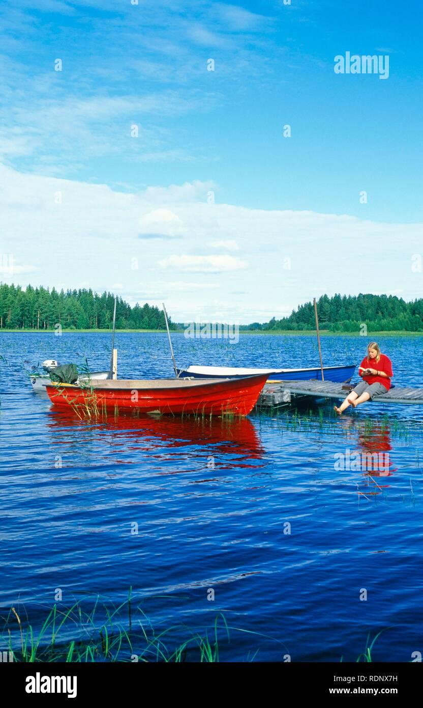 Rowing boats at a wharf in Lake Siljan, Dalarna region, Southern Sweden, Scandinavia, Europe - Stock Image