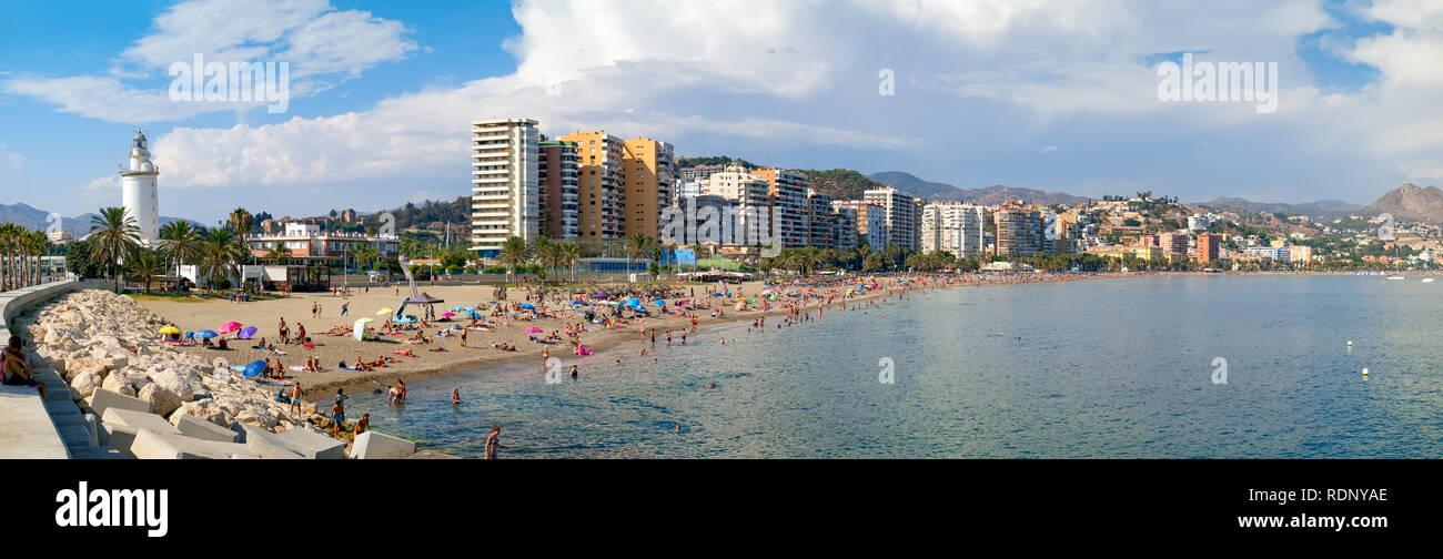Malaga, Spain - August 23, 2018. People on Malagueta beach, Malaga, Costa del Sol, Malaga Province, Andalucia, Spain, Western Europe Stock Photo
