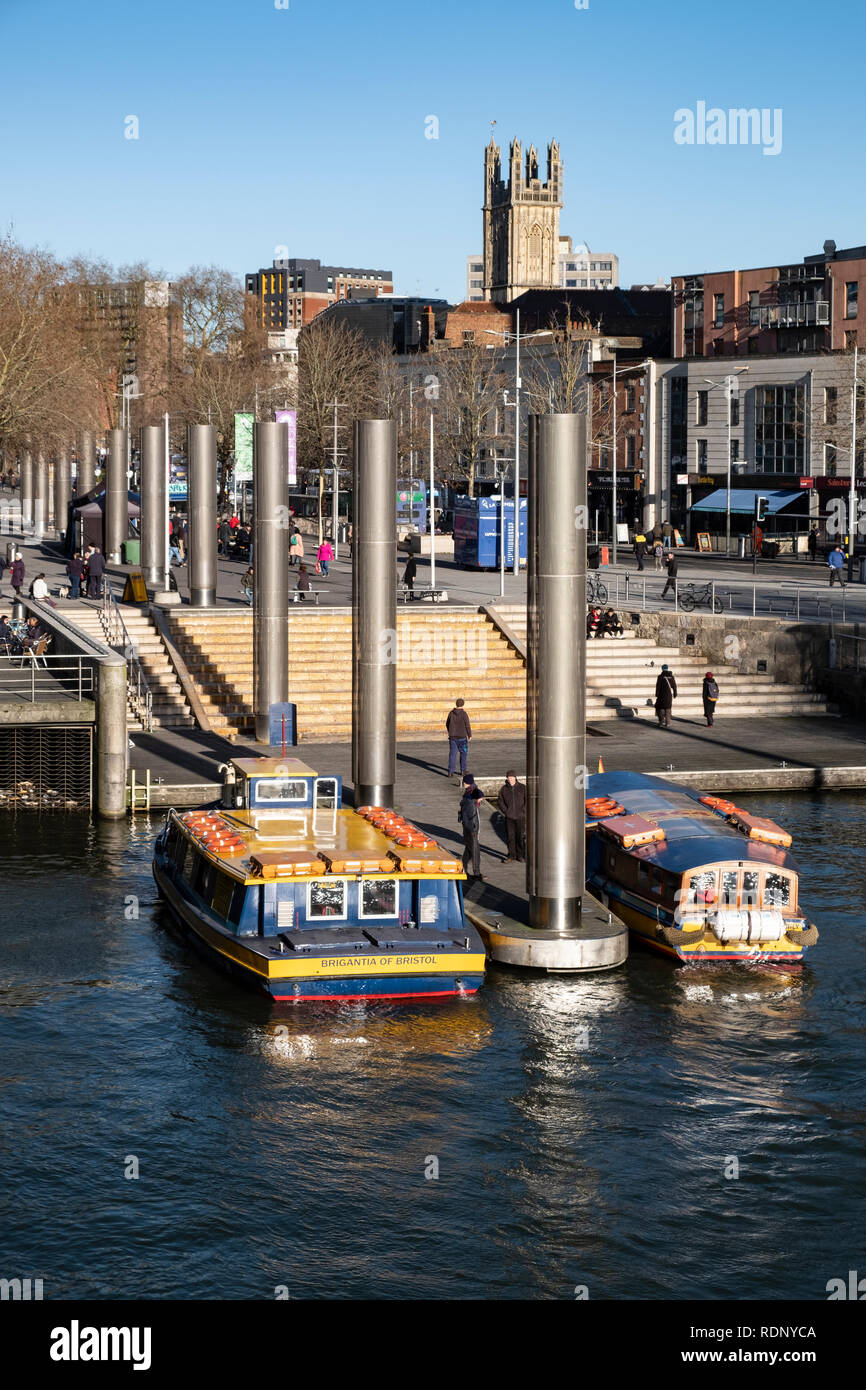 Bristol ferry boats wait at the Centre Landing jetty. The ferries ease city centre congestion by carrying commuters and tourists in the city centre. - Stock Image