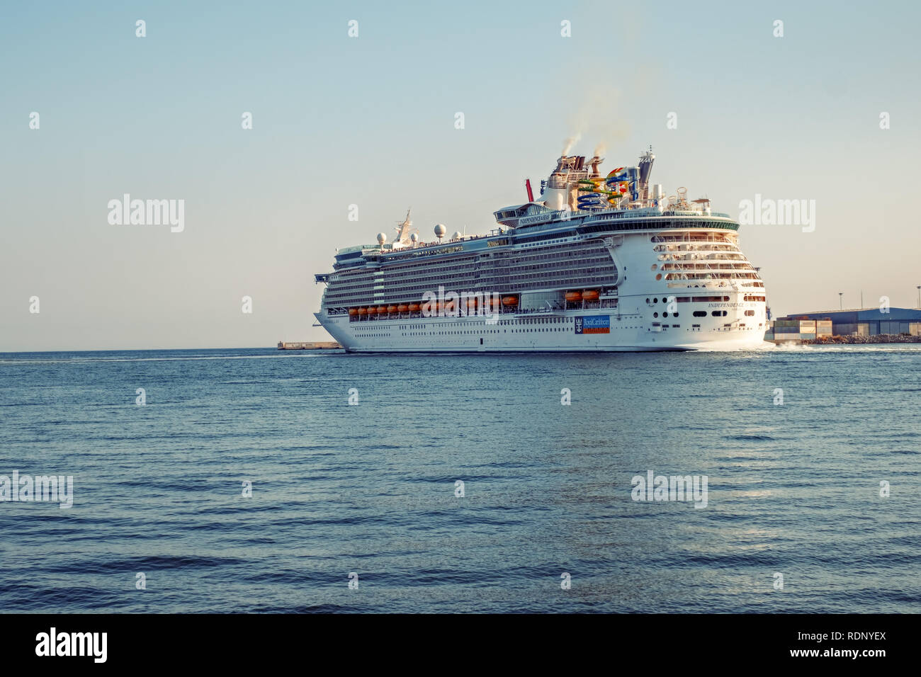 Malaga, Spain - June 26, 2018. Royal Caribbean Independence of the Seas cruise ship leaves the port of Malaga city, Costa del Sol, Malaga Province, An - Stock Image