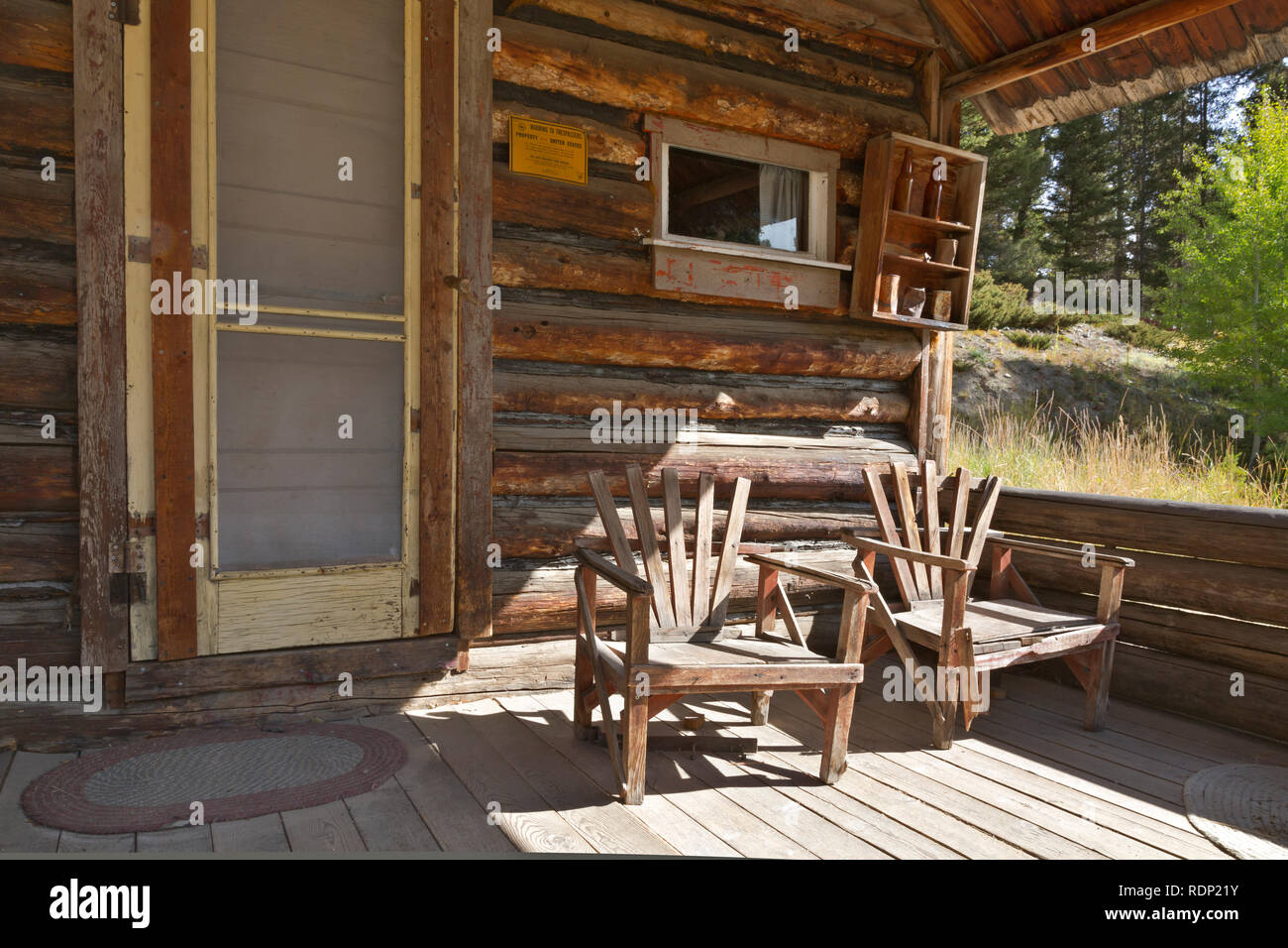 MT00277-00...MONTANA - Chairs on the porch of the Ole Dahl residence at the ghost town of Garnet, now a tourist destination run by the Bureau of Land  - Stock Image