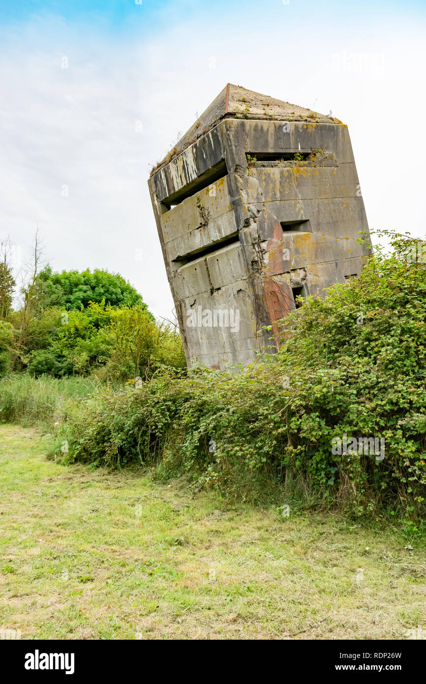 Tilted original old German bunker from World War II La Tour Penchee (the leaning tower) in Oye Plage, Nord-Pas-de-Calais, France. - Stock Image