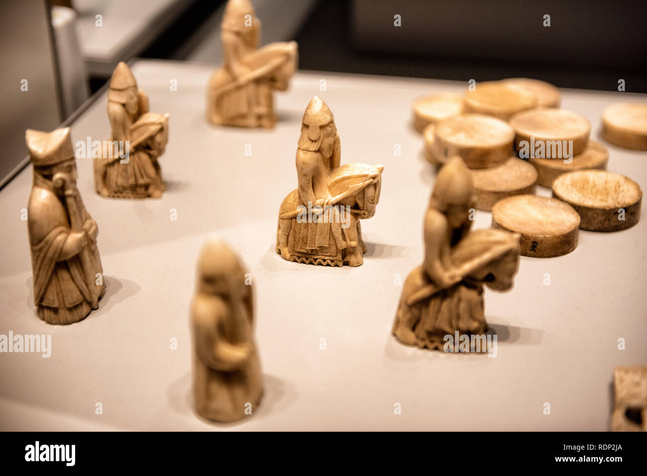 The Lewis Chessmen (or Uig Chessmen) is a collection of elaborately carved walrus ivory chessmen and gaming counters dating to the 12th century. They  - Stock Image