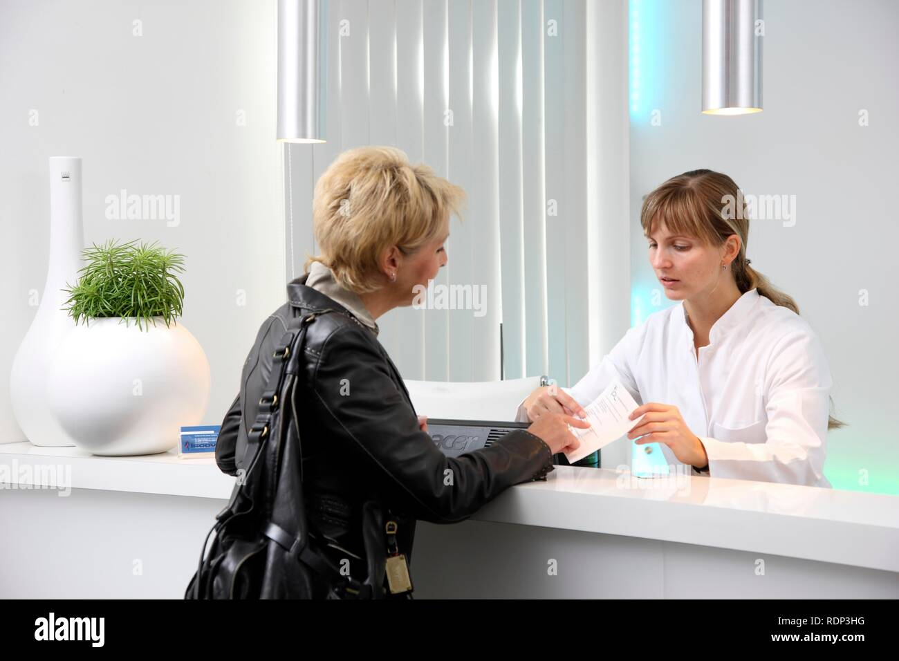 Medical practice, patient is greeted by a medical secretary - Stock Image