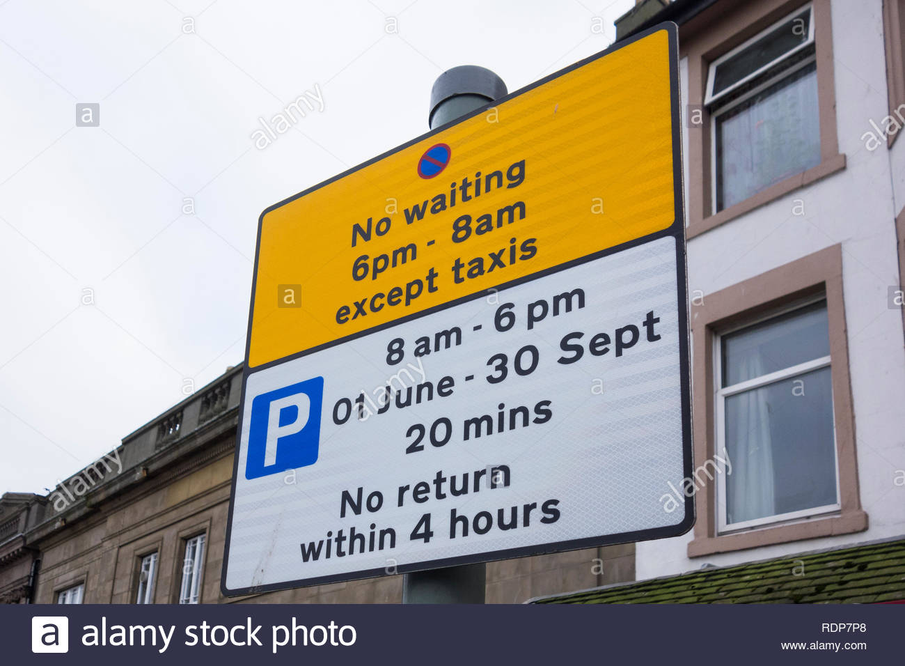 Parking sign in Morecambe, Lancashire, England, UK with time and seasonal limits - Stock Image