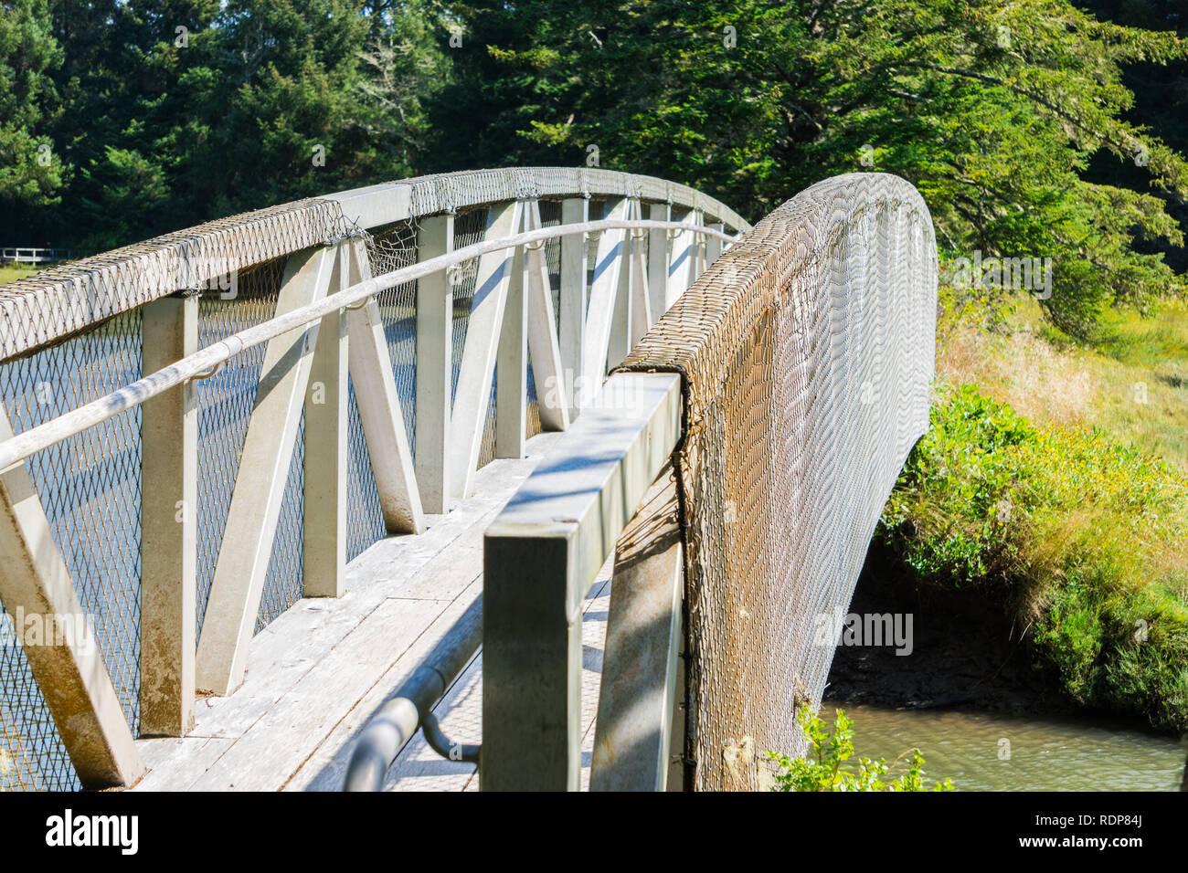 White wooden bridge, South Slough National Estuarine Research Reserve, Coos Bay, Oregon - Stock Image
