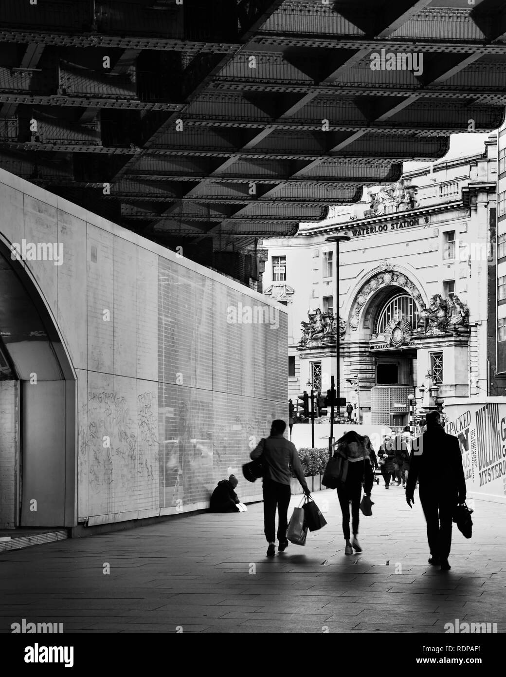 Commuters heading into Waterloo station in London, UK - Stock Image