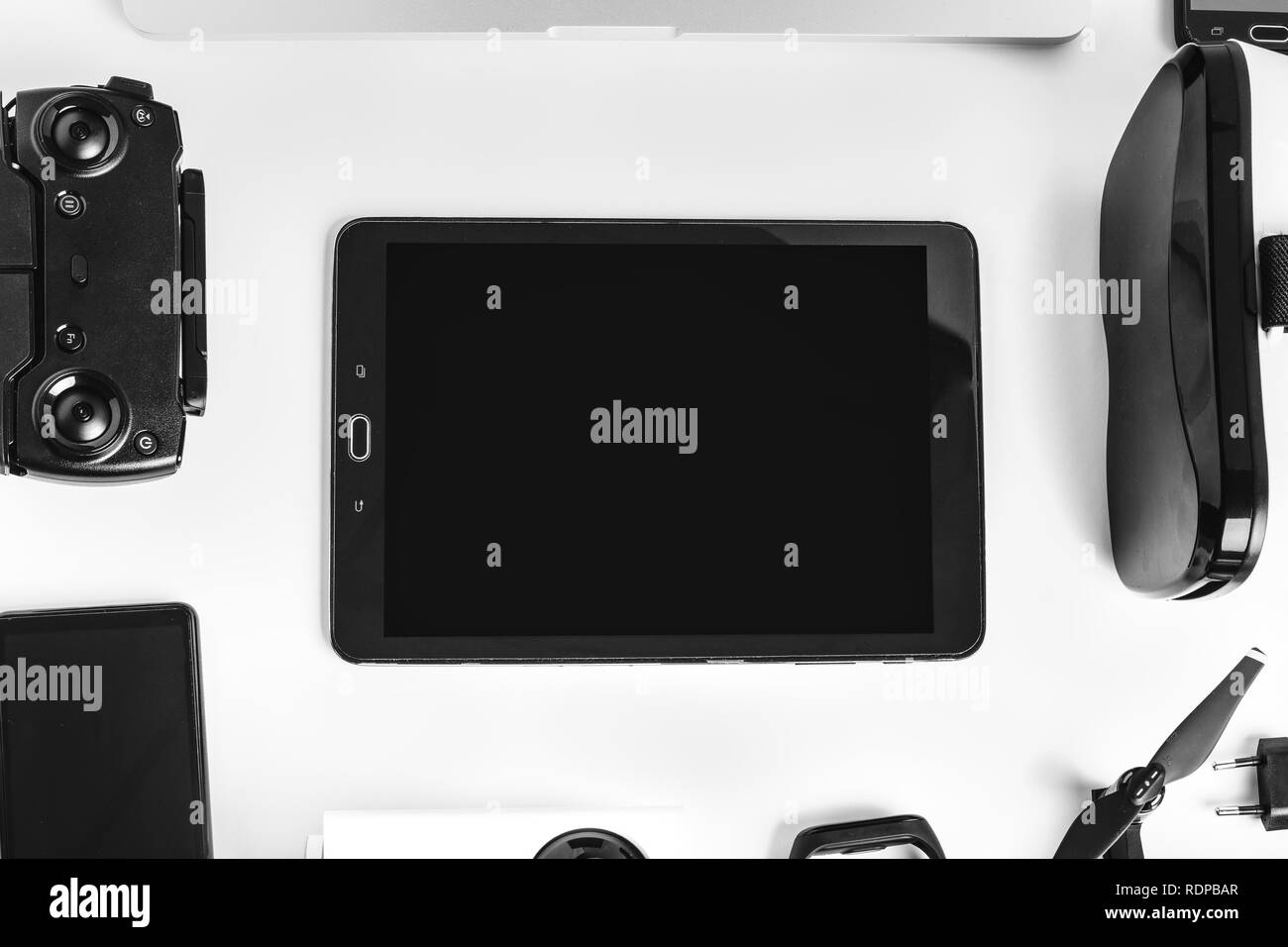 modern gadgets in the form of a frame on a white background in the center of the tablet - Stock Image