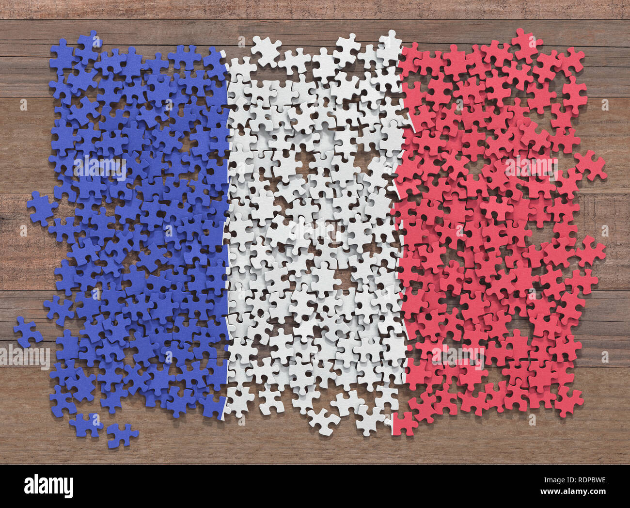 French flag made up of separate jigsaw puzzle pieces, illustration. - Stock Image
