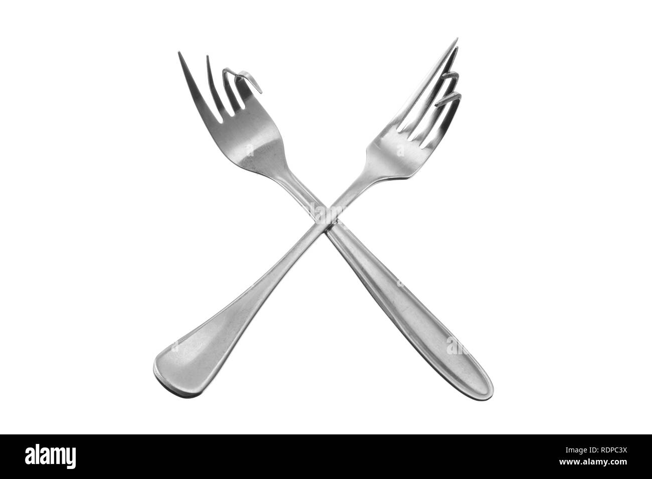 Bent Forks on White Background - Stock Image