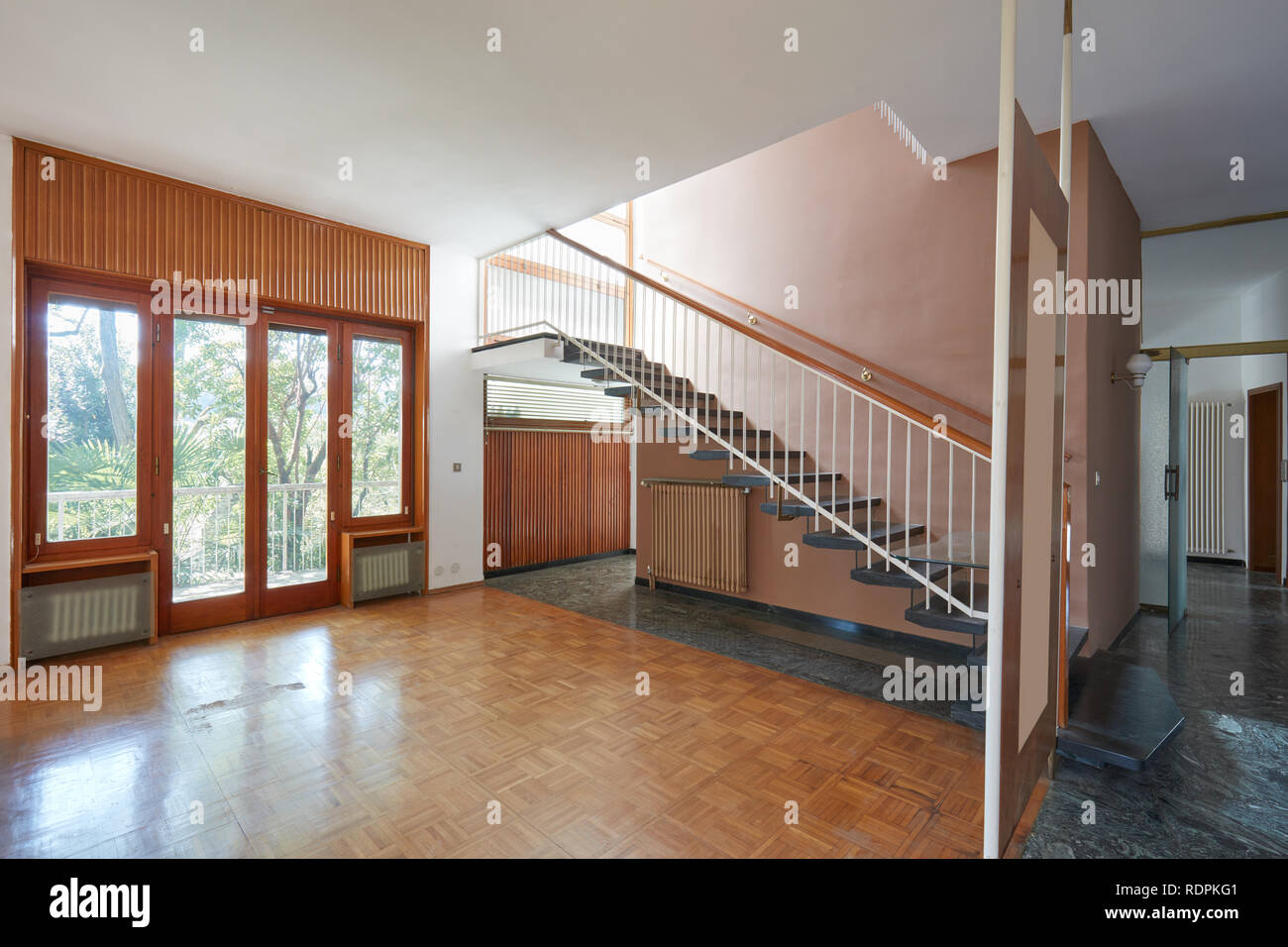 Empty Living Room With Staircase Apartment Interior In Old