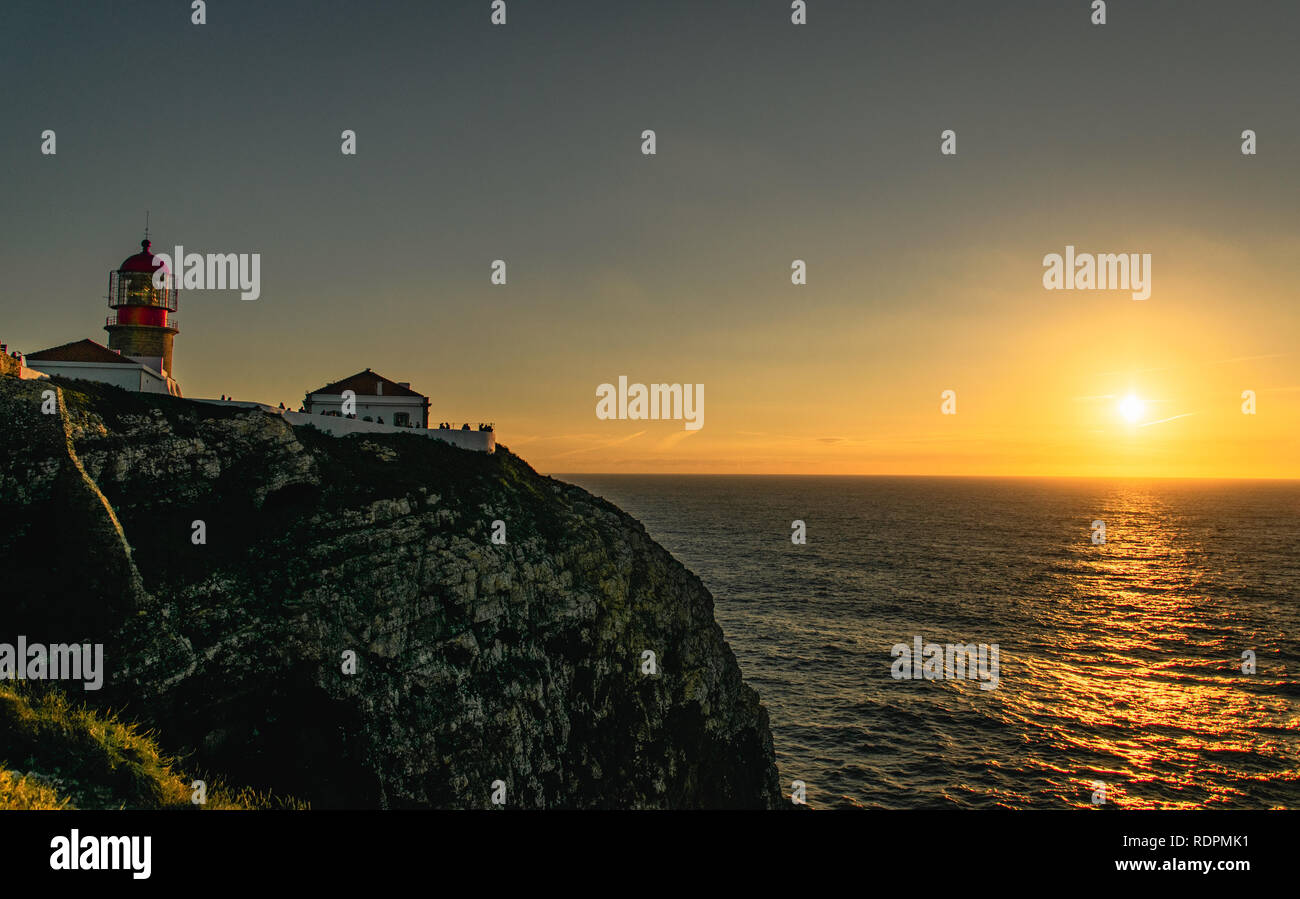 Sunset and Lighthouse - Stock Image