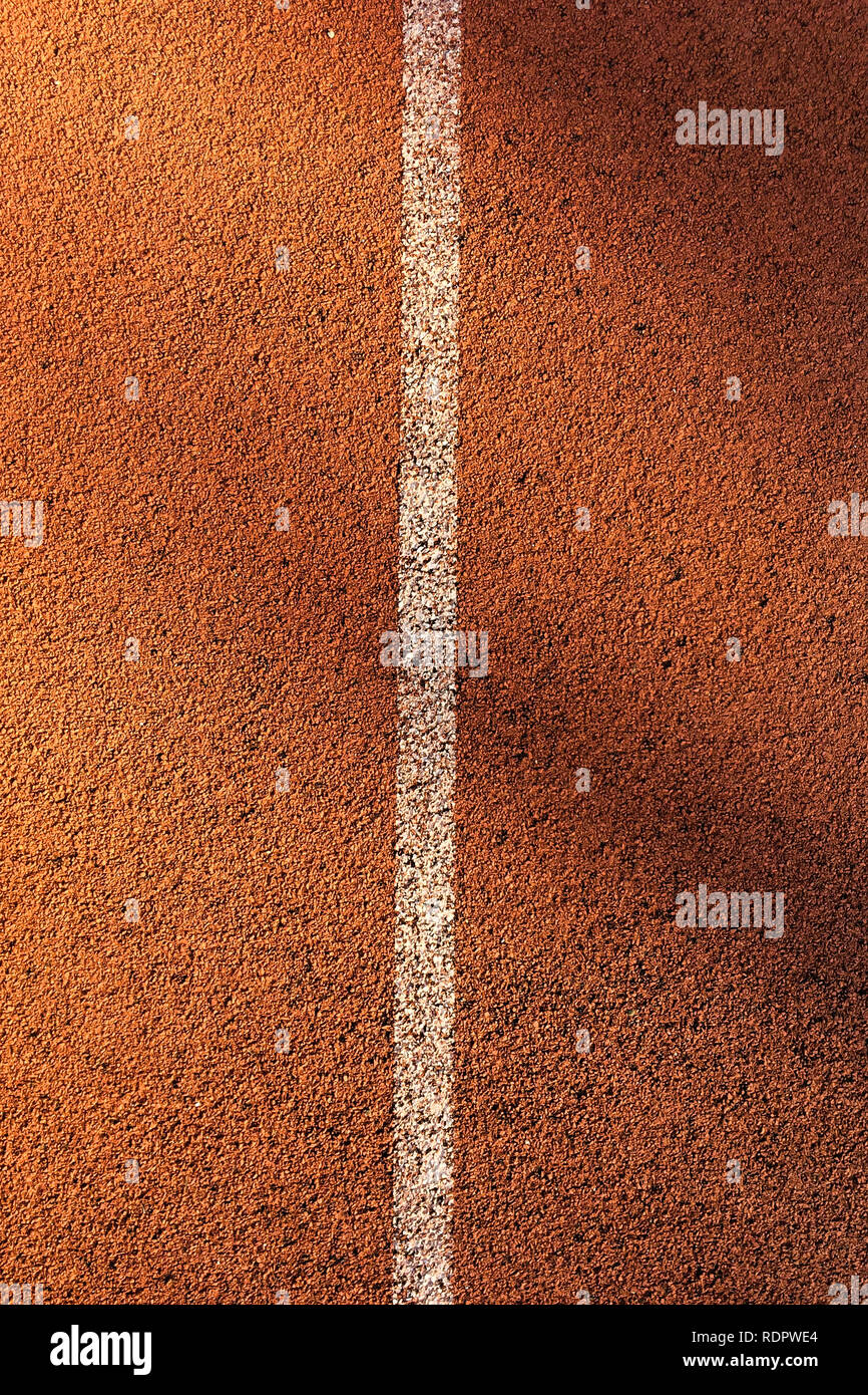 running track field with white line top view texture - Stock Image