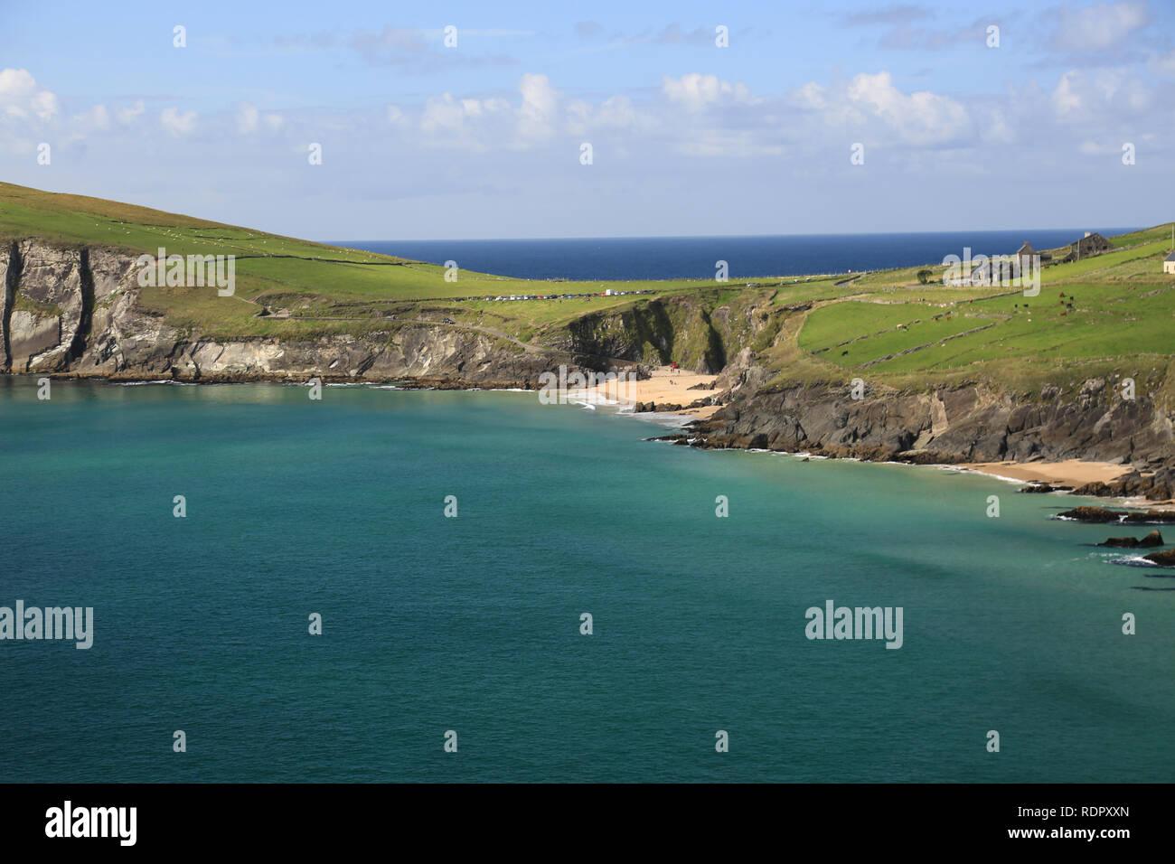 calm atlantic sea lapping on to coast on wild atlantic way, county kerry, ireland - Stock Image