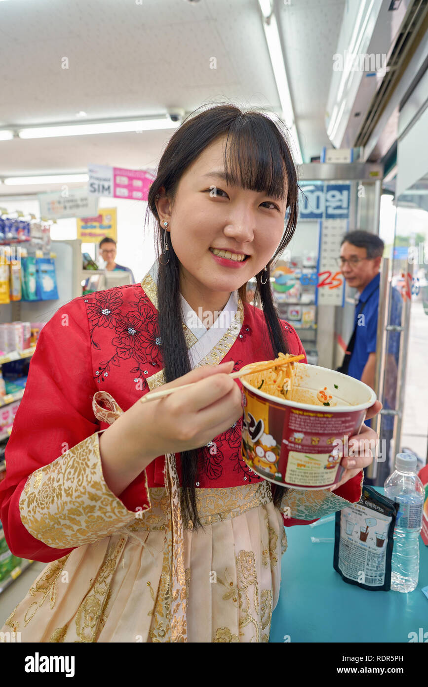 SEOUL, SOUTH KOREA - CIRCA MAY, 2017: woman at GS25 convenience store in Seoul. GS25 is a convenience store brand in South Korea. Stock Photo