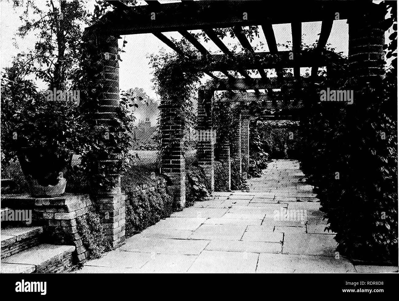 . Gardens for small country houses . Gardens, English. FIG. 261.—PIERS OF BRICK AND STONE.. FIG. 262.—A PERGOLA WITH PIERS, SOME ROUND, SOME SQUARE.. Please note that these images are extracted from scanned page images that may have been digitally enhanced for readability - coloration and appearance of these illustrations may not perfectly resemble the original work.. Jekyll, Gertrude, 1843-1932; Weaver, Lawrence, Sir, 1876-. London : Published at the offices of Country Life . .. and by George Newnes . .. ; New York : Charles Scribner's Sons - Stock Image