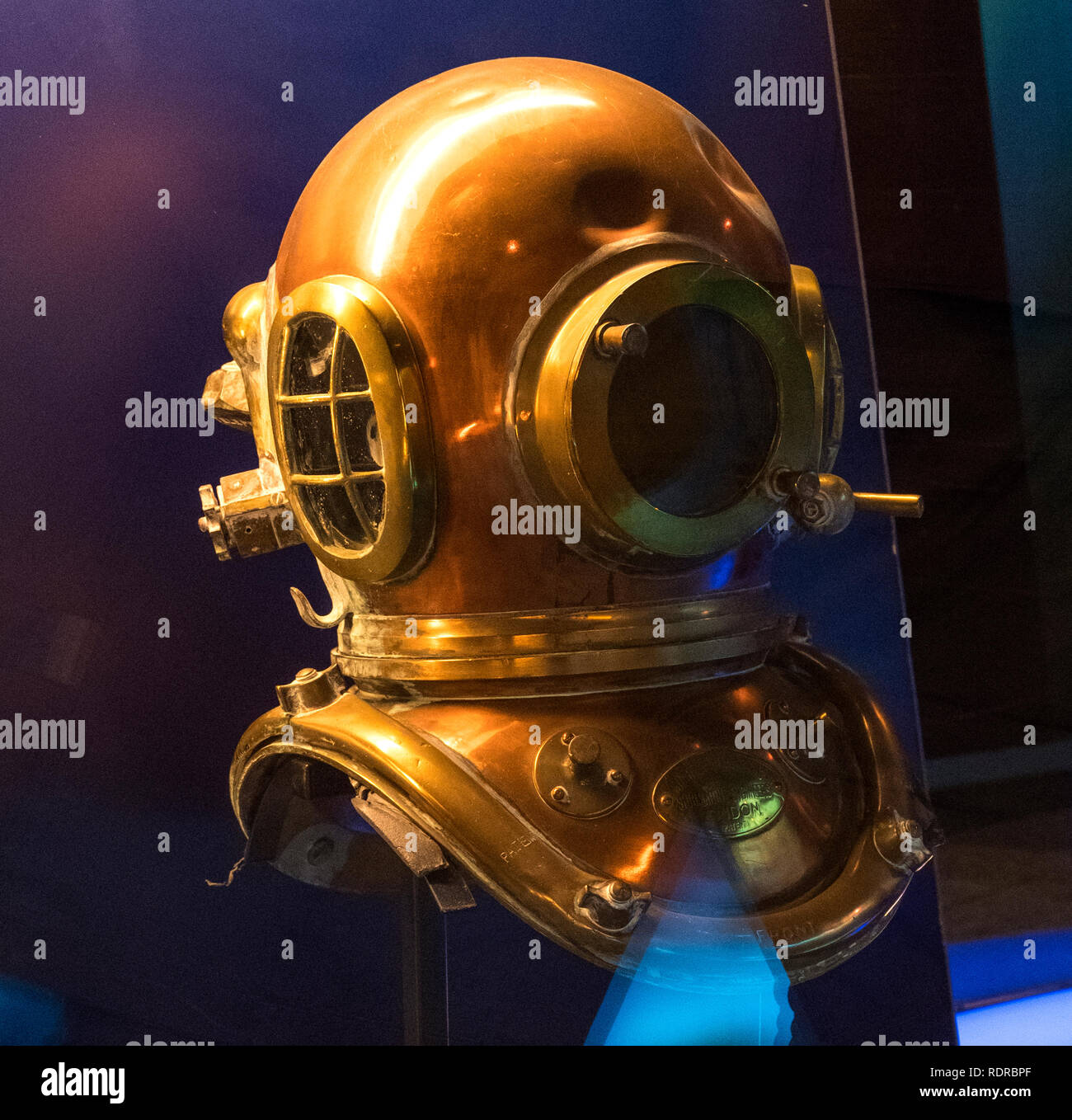 Cherbourg, France - August 26, 2018: Copper diving helmet in the maritime museum La Cite de La Mer or City of the Sea in Cherbourg, Normandy, France Stock Photo