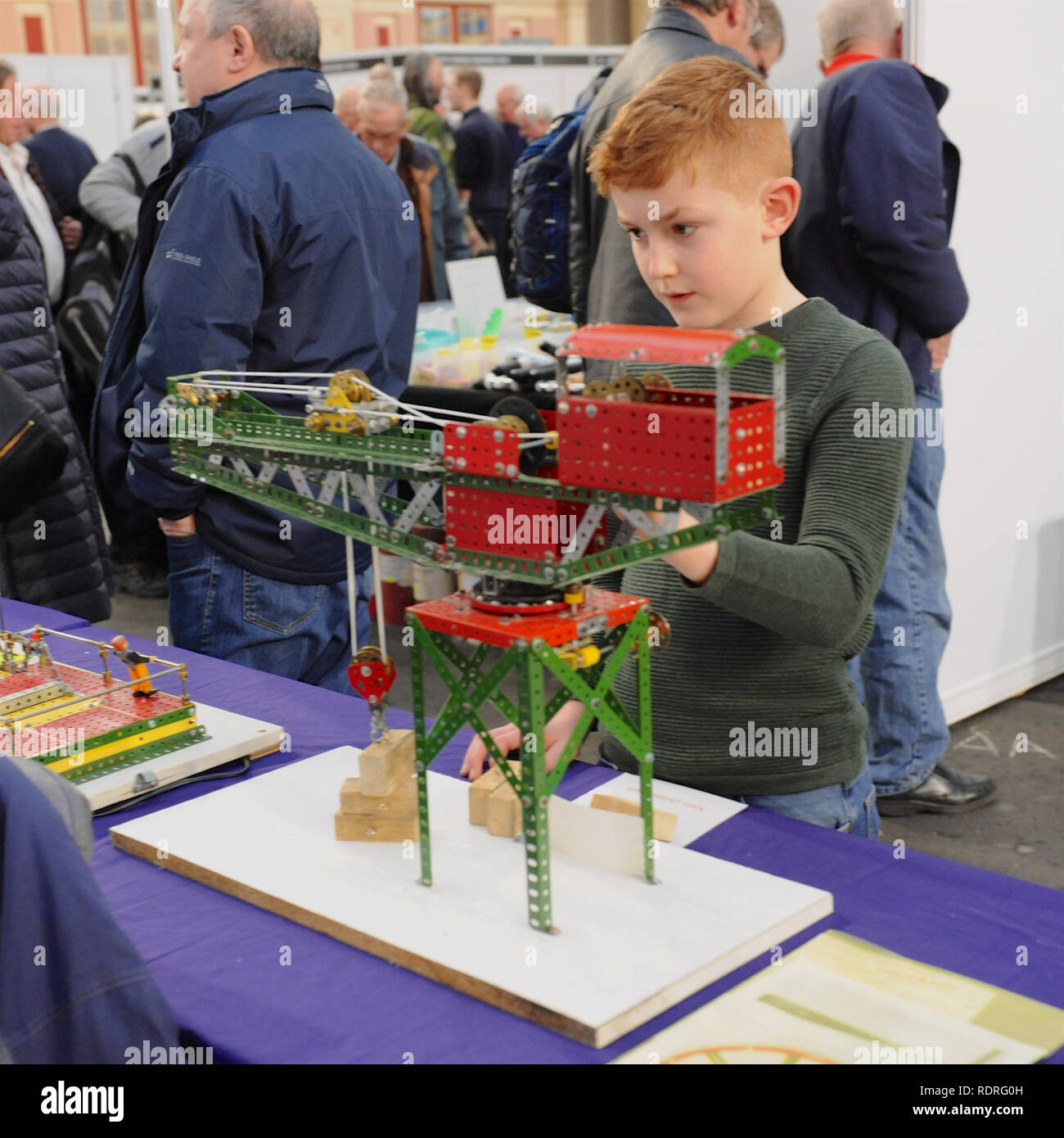 Alexandra Palace, London, UK. 18th Jan 2019. A boy playing with a Meccano crane at the London Model Engineering Exhibition, Alexandra Palace, London.  The London Model Engineering Exhibition is now in its 23rd year, and attracts around 14,000 visitors.   Credit: Michael Preston/Alamy Live News Stock Photo
