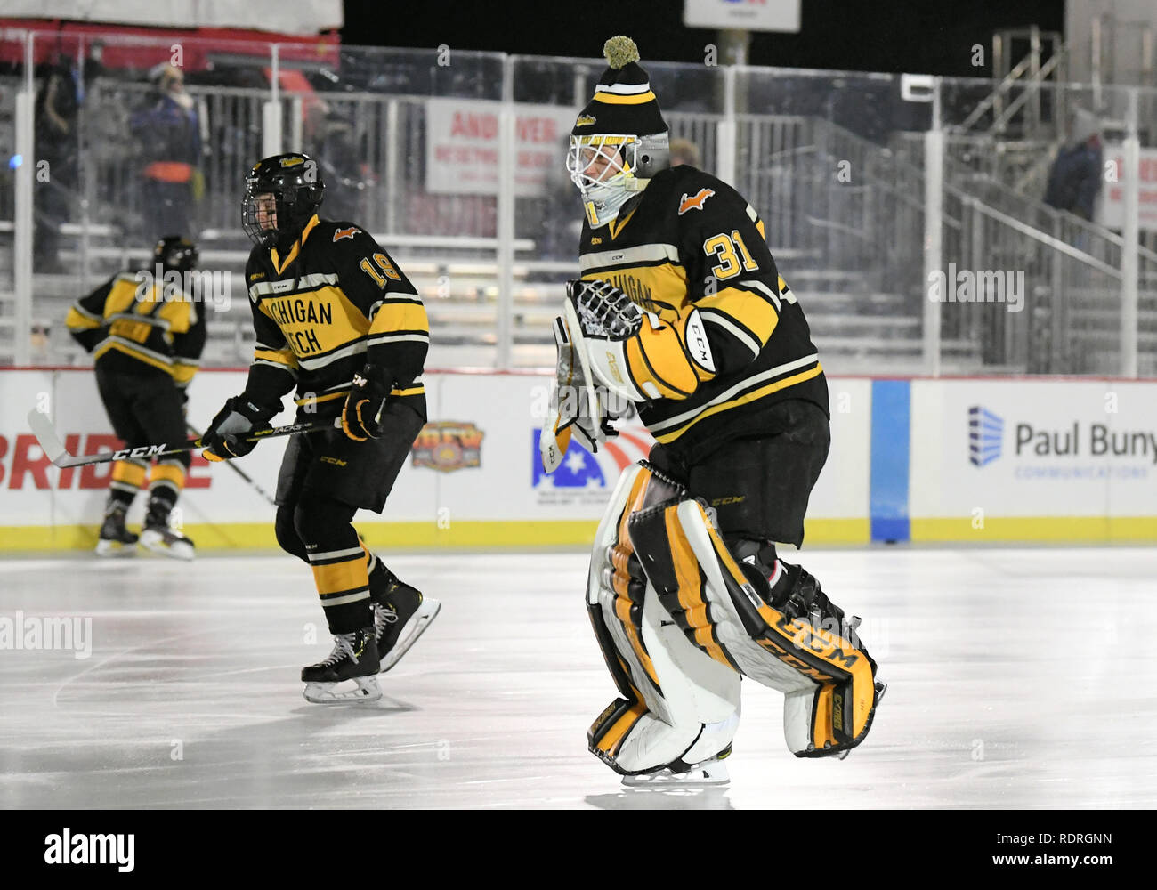 Bemidji, Minnesota, USA. 18th Jan 2019. Michigan Tech Huskies goaltender Devin Kero (31) and Michigan Tech Huskies forward Greyson Reitmeier (18) warmup before an outdoor NCAA men's college hockey game for Hockey Day Minnesota between the Michigan Tech Huskies and the Bemidji State Beavers in Bemidji, MN. Photo by Russell Hons/CSM Credit: Cal Sport Media/Alamy Live News - Stock Image