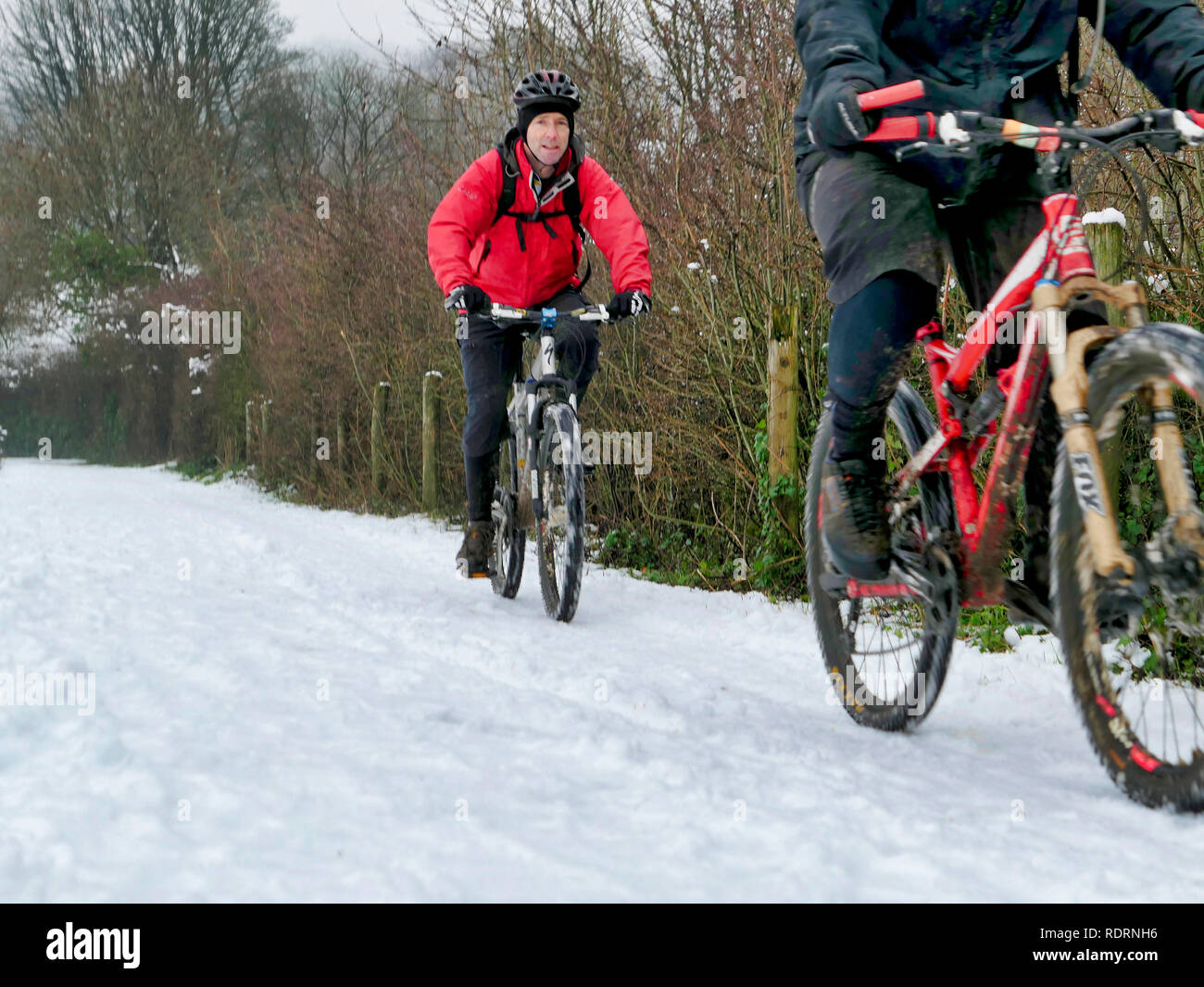 UK Weather: mountain bikers enjoying the snow conditions along the High Peak Trail, Black Rocks, Bolehill, Derbyshire, Peak District National Park Credit: Doug Blane/Alamy Live News Stock Photo