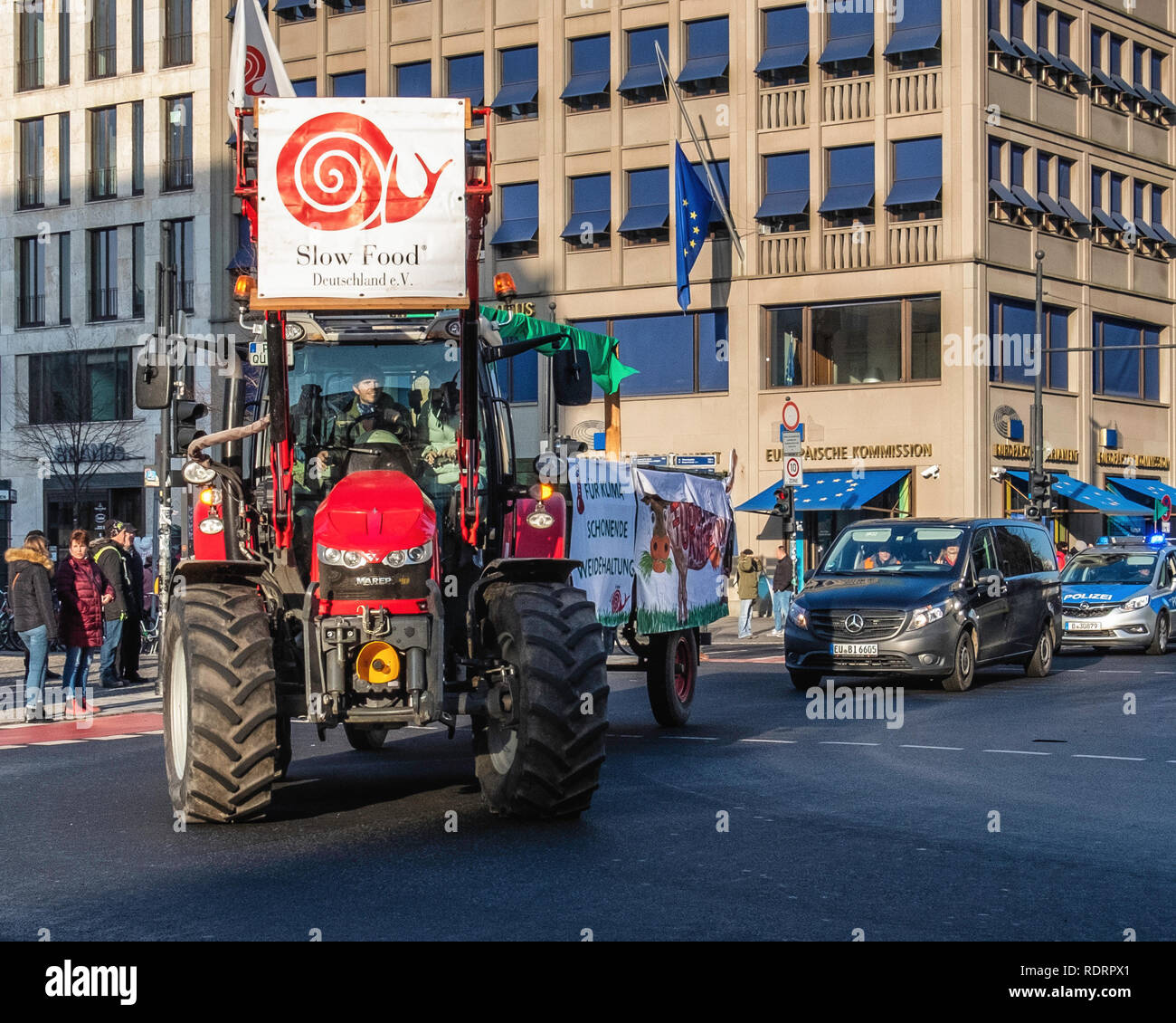 Berlin, Gemany, 19 January 2019. Farmers protest against the EU farm subsidies in Germany. A Parade of tractors  drove past the European Commission building in Unter den Linden as they took part in the protest march against current agricultural policy. Activists protest that large farming enterprises are favoured over smaller farms that support environmentally friendly methods. credit: Eden Breitz/Alamy Live News Credit: Eden Breitz/Alamy Live News - Stock Image