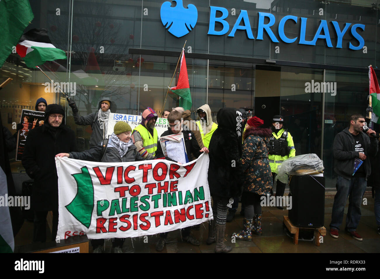 Manchester, UK. 19th January 2019. Pro Palestinian protesters outside Barclays bank during International week of action called by the Manchester boycott Israel group in solidarity with the Palestinian Prisoner Solidarity Network.  19th January 2019 (C)Barbara Cook/Alamy Live News Credit: Barbara Cook/Alamy Live News - Stock Image