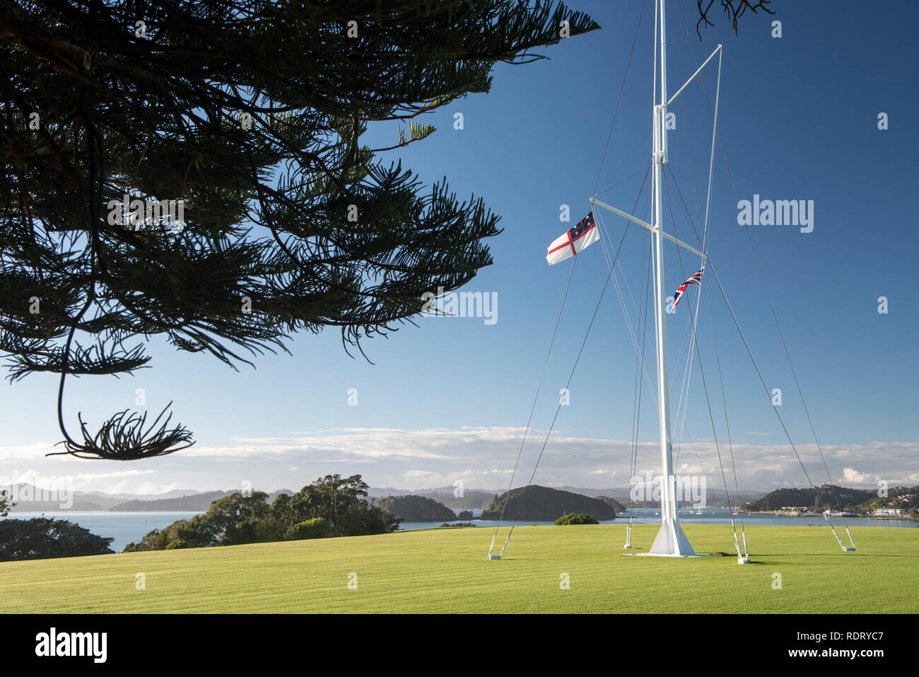 The flagstaff marks the spot where the Treaty of Waitangi was first signed on 6 February 1840. It was erected by the Royal New Zealand Navy in 1934 an - Stock Image