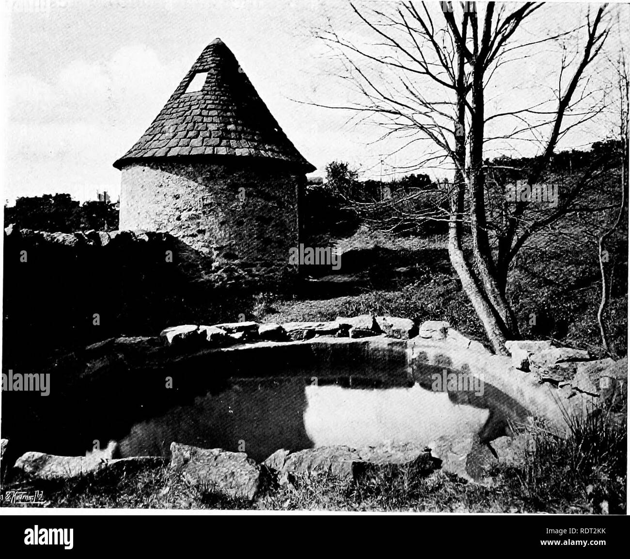 """. Gardens for small country houses . Gardens, English. FIG. 231.—AT KELSALE MANOR.. FIG. 232. —BATHING POOL AT STONEYWELL COTTAGE. attractive thing. The modern example illustrated in Fig. 234 has a simple stone wa:ll and coping with a wrought-iron """" overthrow """" of neat design. Most people, however, who are set on possessing a well- head look for an old one. There seems no end to the stream of them, old or """" antique,"""" which does not necessarily mean the same thing in these days of skilful! reproduction. They come, or are said to come, from Italian courtyards and gardens, som - Stock Image"""