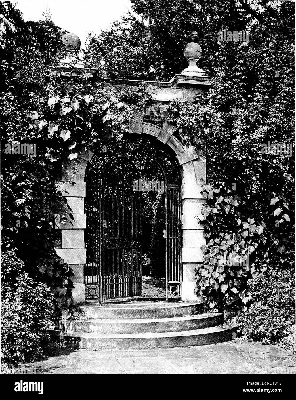 . Gardens for small country houses . Gardens, English. 114 Gardens for Small Country Houses.. FIG. 150.—STONE GATEWAY MODERATELY CLOTHED.. Please note that these images are extracted from scanned page images that may have been digitally enhanced for readability - coloration and appearance of these illustrations may not perfectly resemble the original work.. Jekyll, Gertrude, 1843-1932; Weaver, Lawrence, Sir, 1876-. London : Published at the offices of Country Life . .. and by George Newnes . .. ; New York : Charles Scribner's Sons - Stock Image