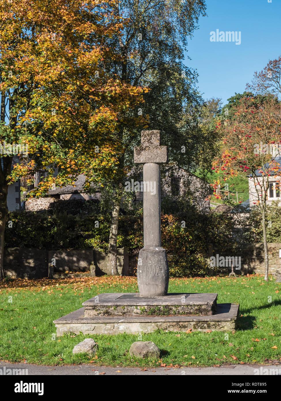 The market square cross at Low Bentham, in northwest England on the Lancashire North Yorkshire border as mentioned in the medieval Doomsday Book - Stock Image