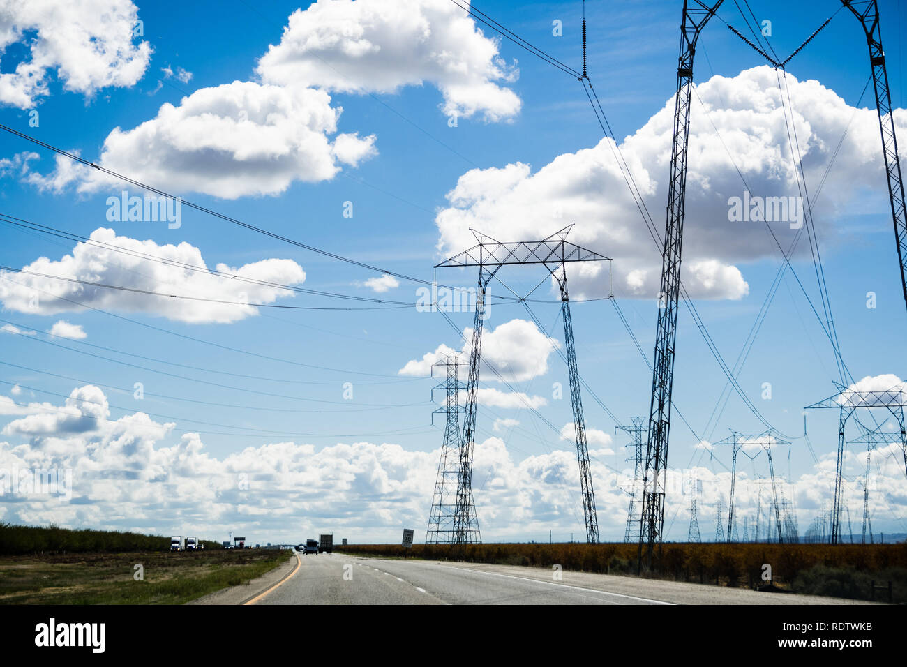 View of high voltage towers and lines while driving on I-5 interstates, south California - Stock Image