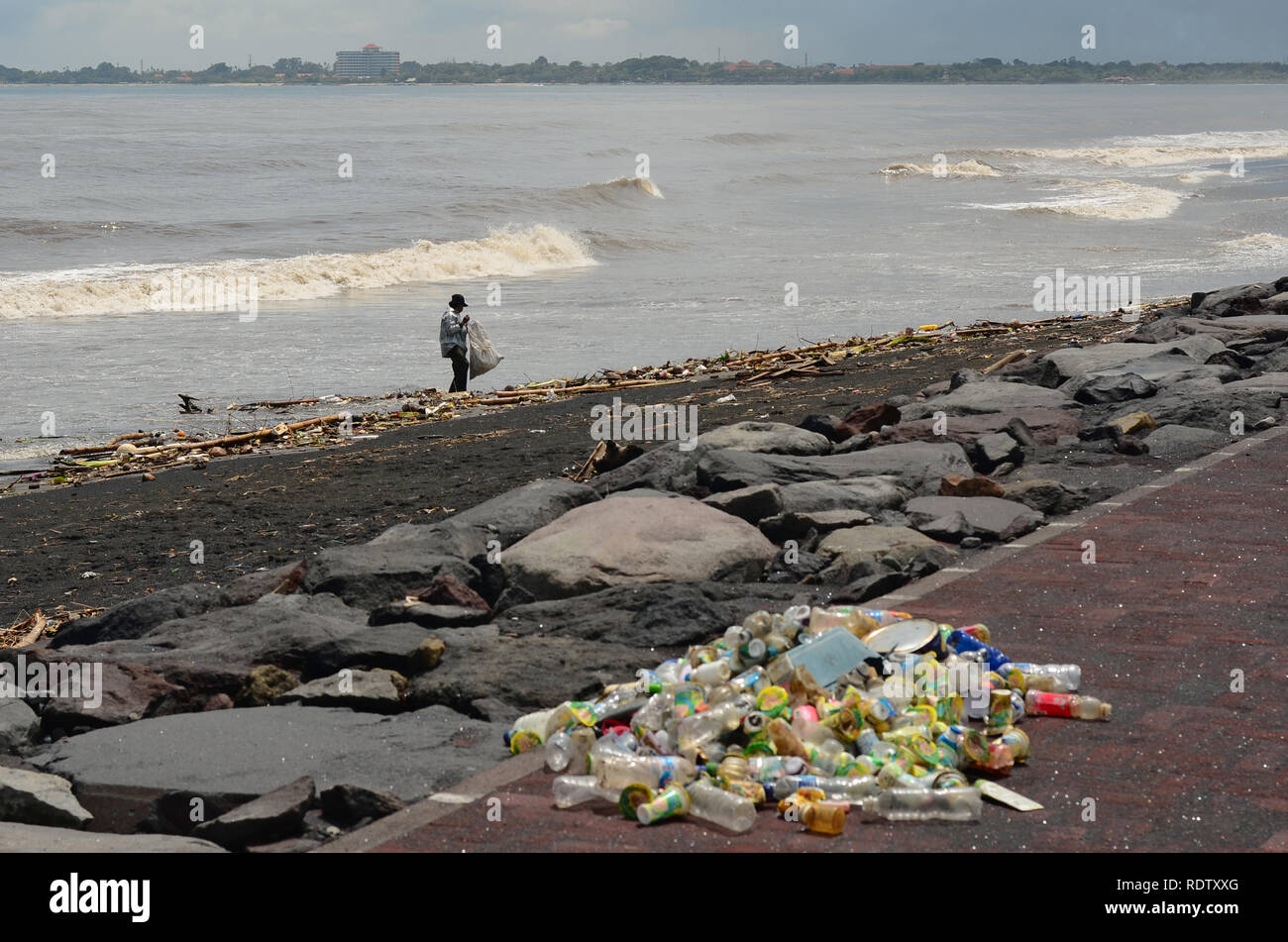 People Collects Plastic Bottles on The Polluted Coast - Stock Image