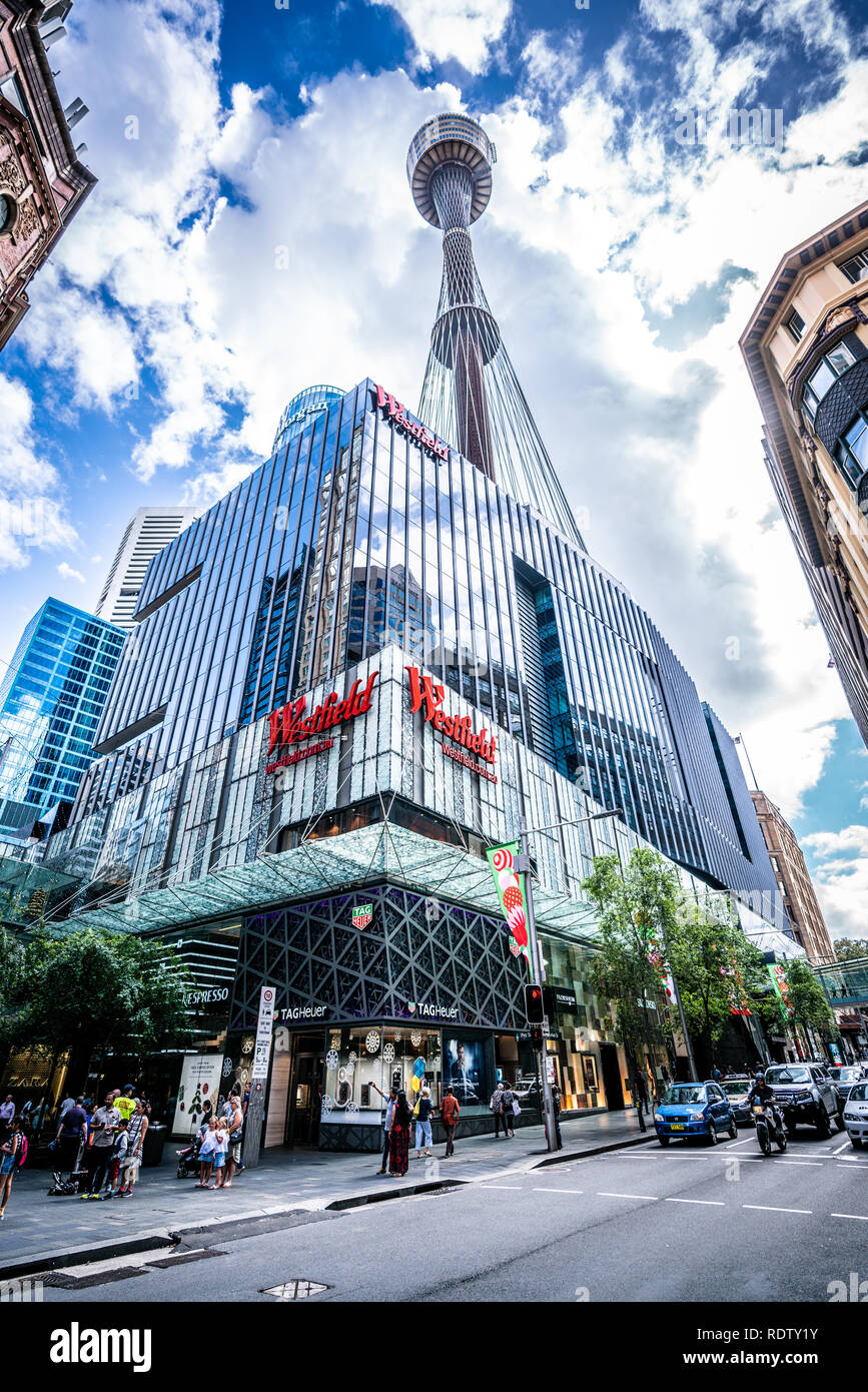 23th December 2018, Sydney NSW Australia: vertical low-angle street view in Sydney CBD with Westfield shopping centre and Sydney tower eye and people  - Stock Image