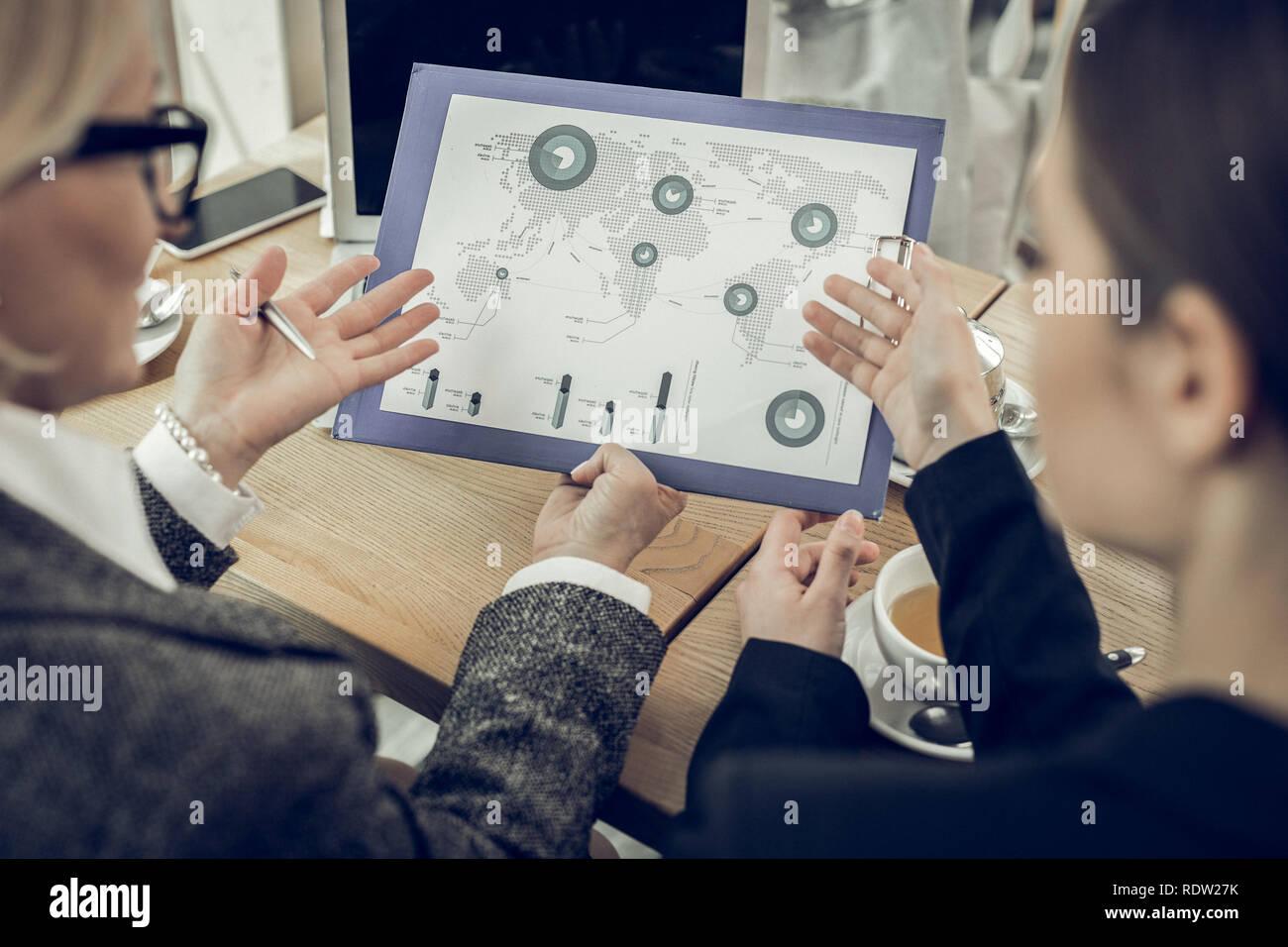 Stylish elegant women working in corporation having negotiation - Stock Image