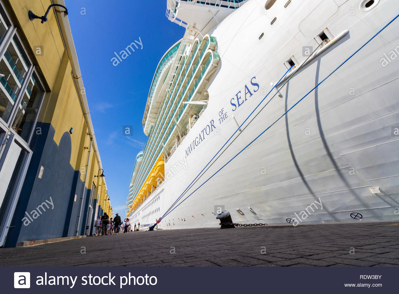 Gibraltar, United Kingdom - May, 15, 2017: Royal Caribbean cruise ship navigator of the seas docked at Gibraltar with tourist getting off to explore. - Stock Image