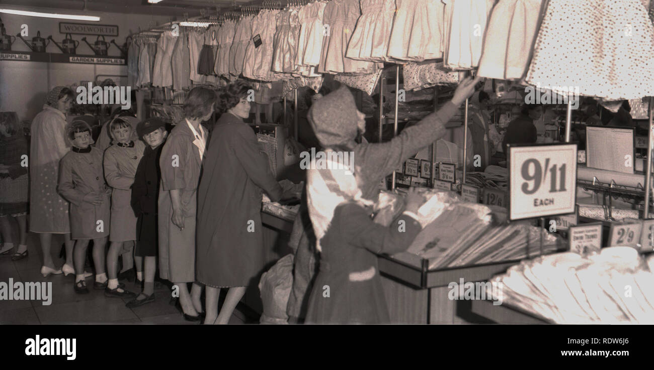 1950s, women and children shopping inside a Woolworth store, England, UK - Stock Image