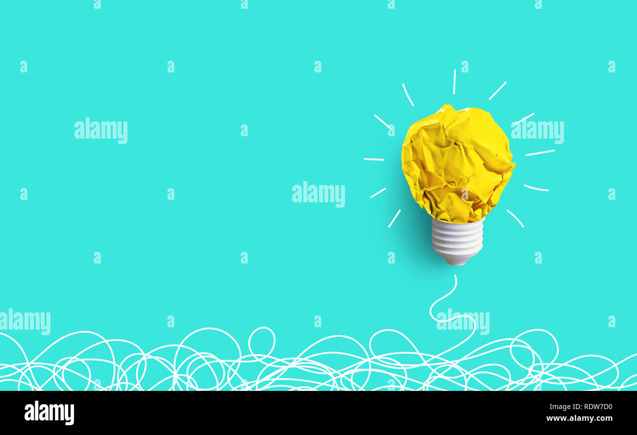 Creativity inspiration,ideas concepts with lightbulb from paper crumpled ball on pastel color background.Flat lay design. - Stock Image