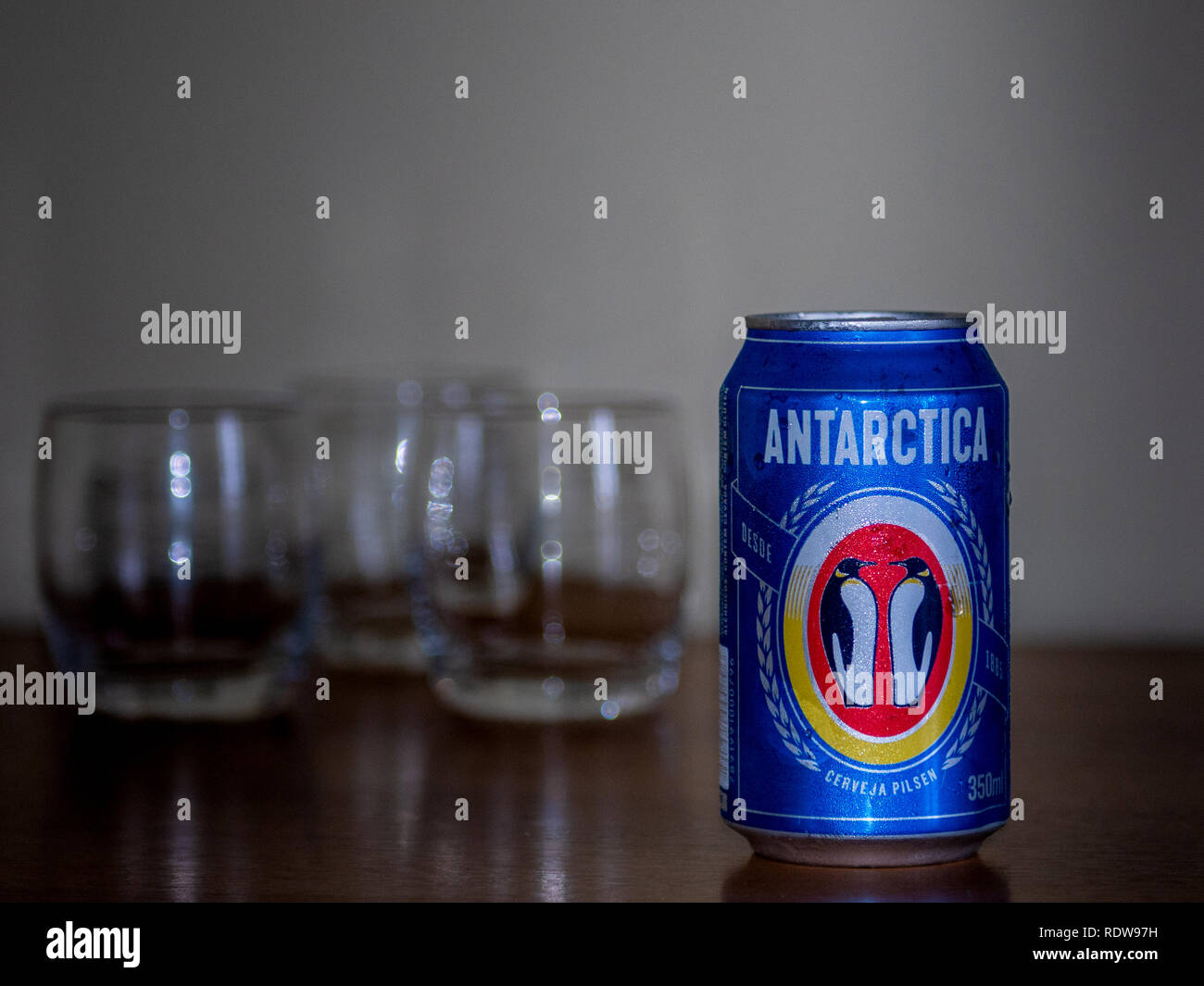 Petropolis, Rio de Janeiro, Brazil- December 26, 2018: A bottle of Antartica beer with three glass cups - Stock Image
