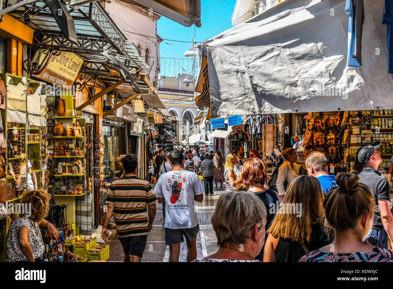 Athens, Greece - September 22 2018: Tourists walk the streets lined with souvenir shops and cafes in the touristic Plaka section of Athens, Greece Stock Photo
