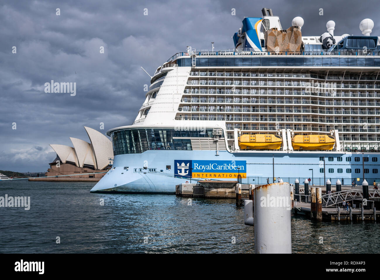23th December 2018, Sydney NSW Australia: Rear of a Ovation of the seas Royal Caribbean International cruise ship with logo and Sydney Opera house in  - Stock Image
