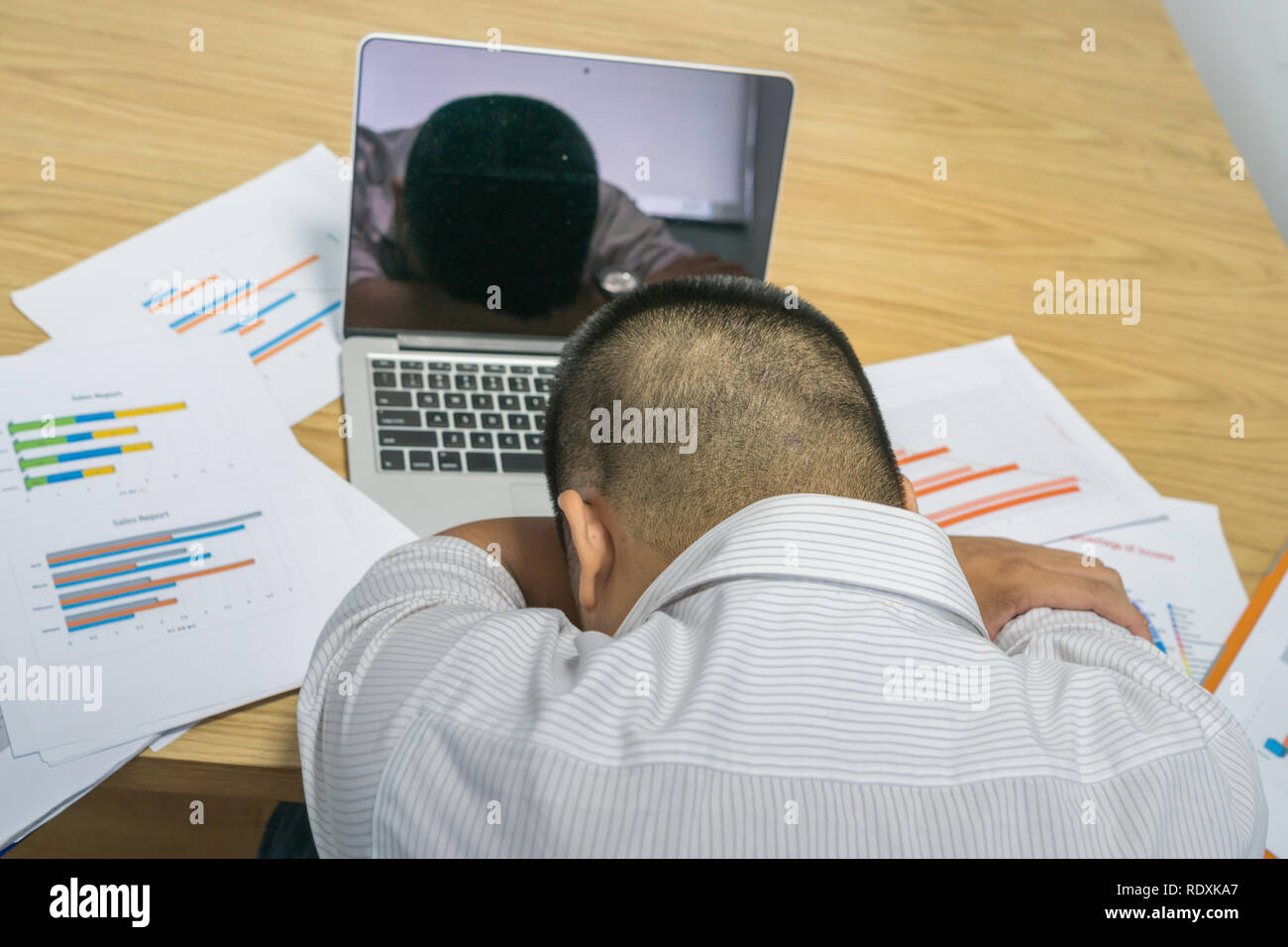 Tired and stressful man overtressed with financial problems - Stock Image