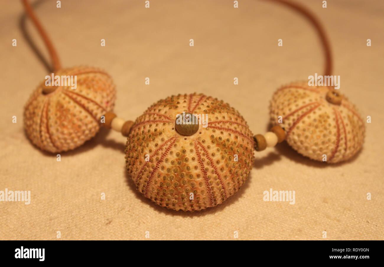 Handamde necklace made of natural materials (sea urchin shells) - Stock Image