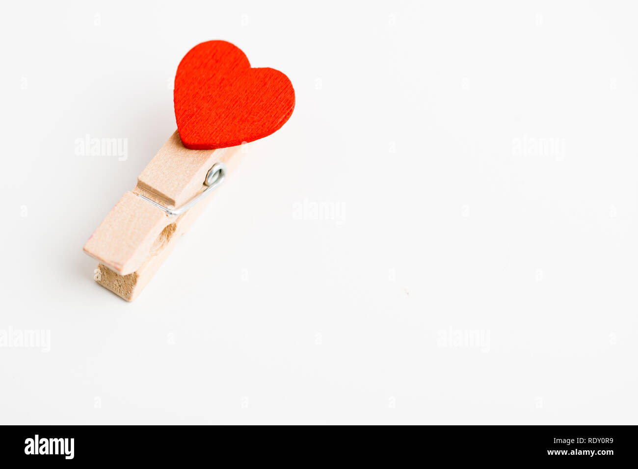 Single cloth pin with heart. Space for text. Stock Photo