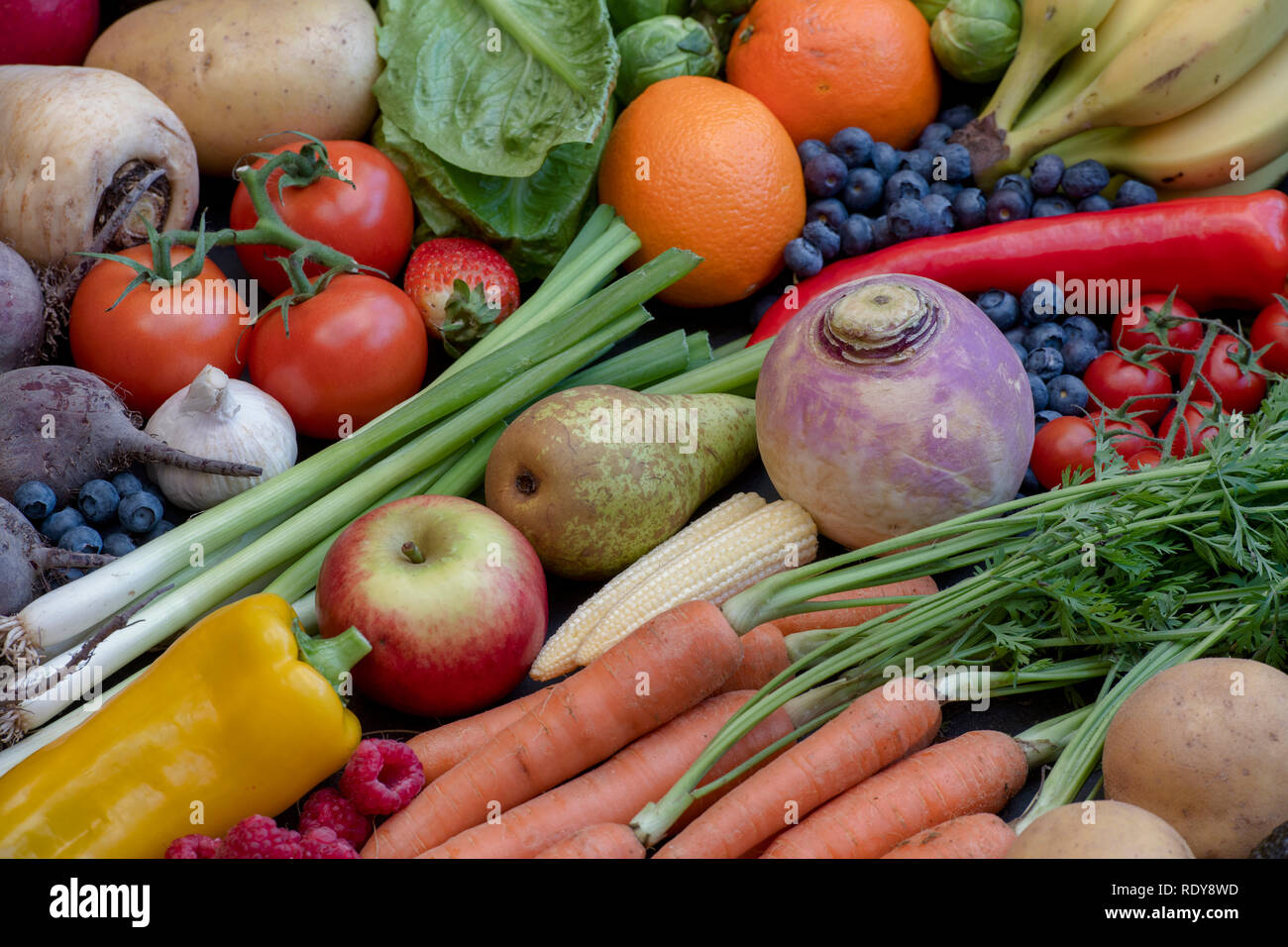 Fruit and vegetables on slate - Stock Image