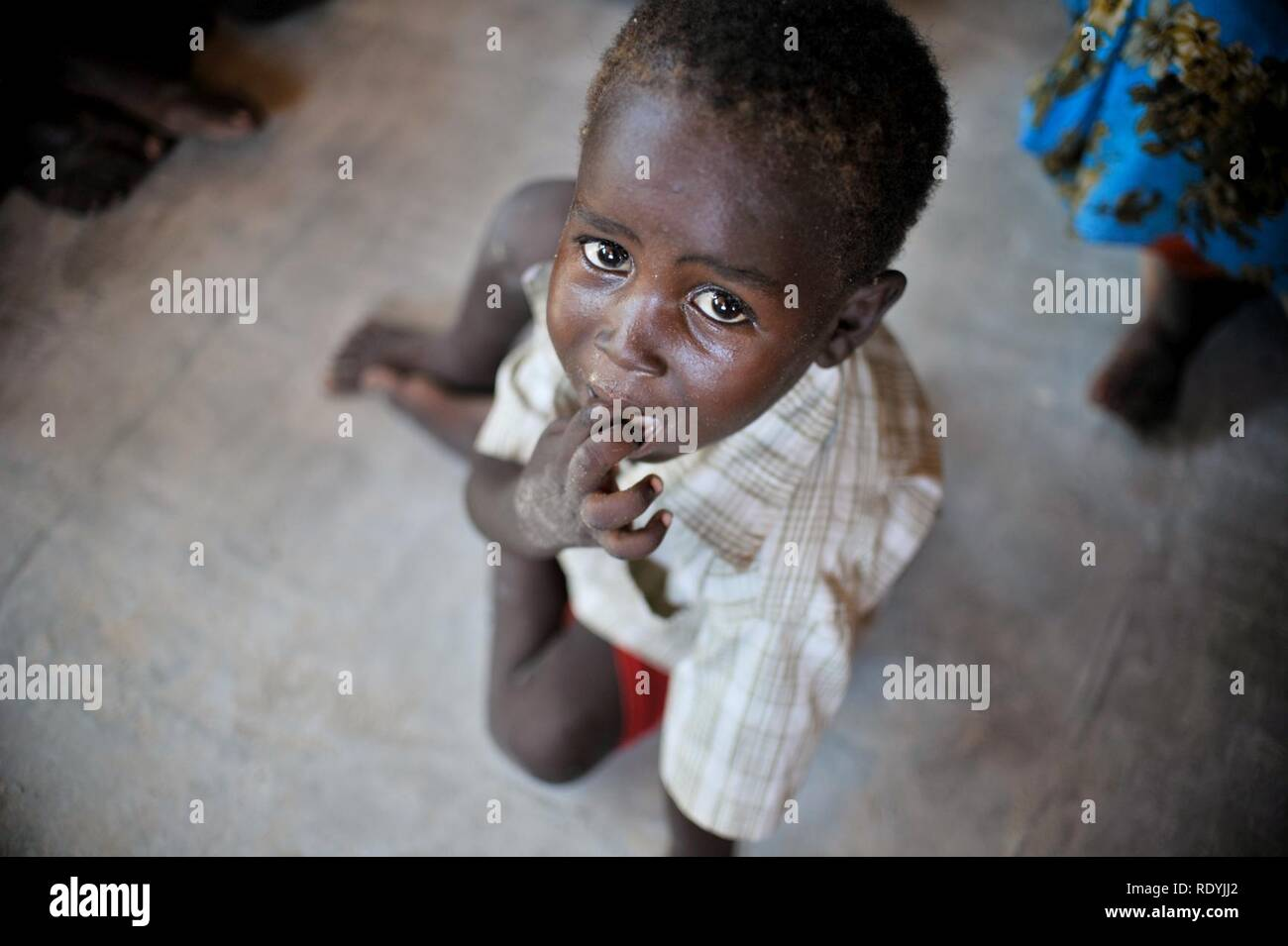 At a clinic held at Jazeera Training Camp on April 6, patients come to a free medical clinic in order to receive treatment for a variety of maladies. Many of the clinic's patients come from Jazeera (8633034093). - Stock Image