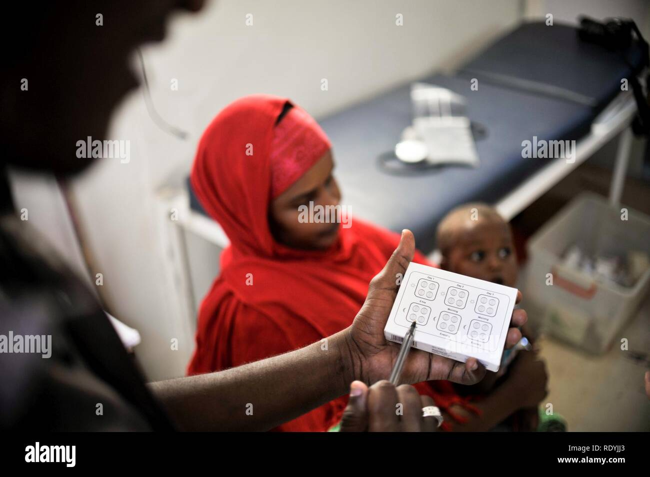 At a clinic held at Jazeera Training Camp on April 6, patients come to a free medical clinic in order to receive treatment for a variety of maladies. Many of the clinic's patients come from Jazeera (8634135908). - Stock Image