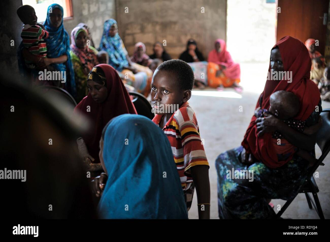 At a clinic held at Jazeera Training Camp on April 6, patients come to a free medical clinic in order to receive treatment for a variety of maladies. Many of the clinic's patients come from Jazeera (8634143746). - Stock Image